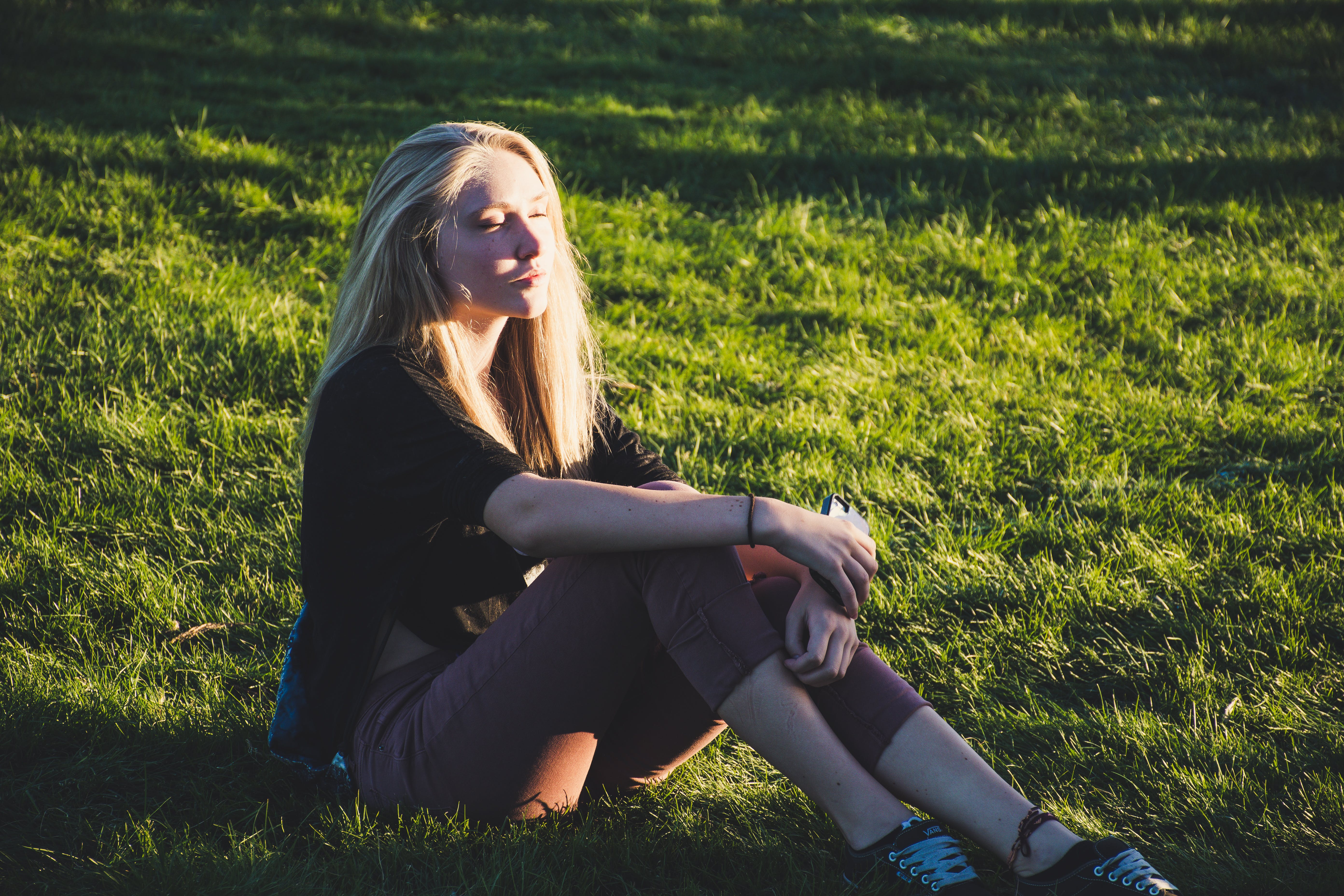Photo of Woman Sitting on Grass