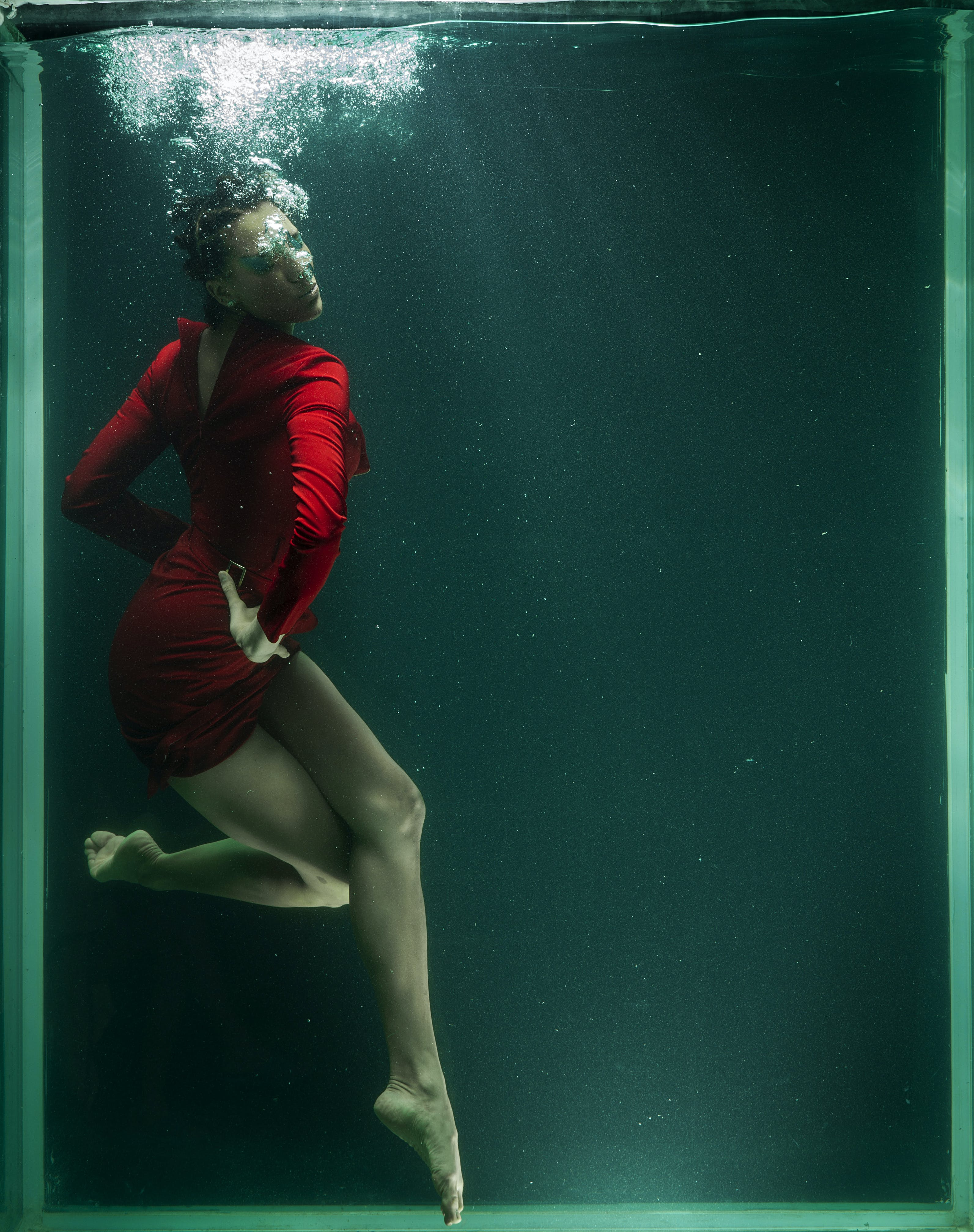 Photo of Woman Wearing Red Dress Underwater