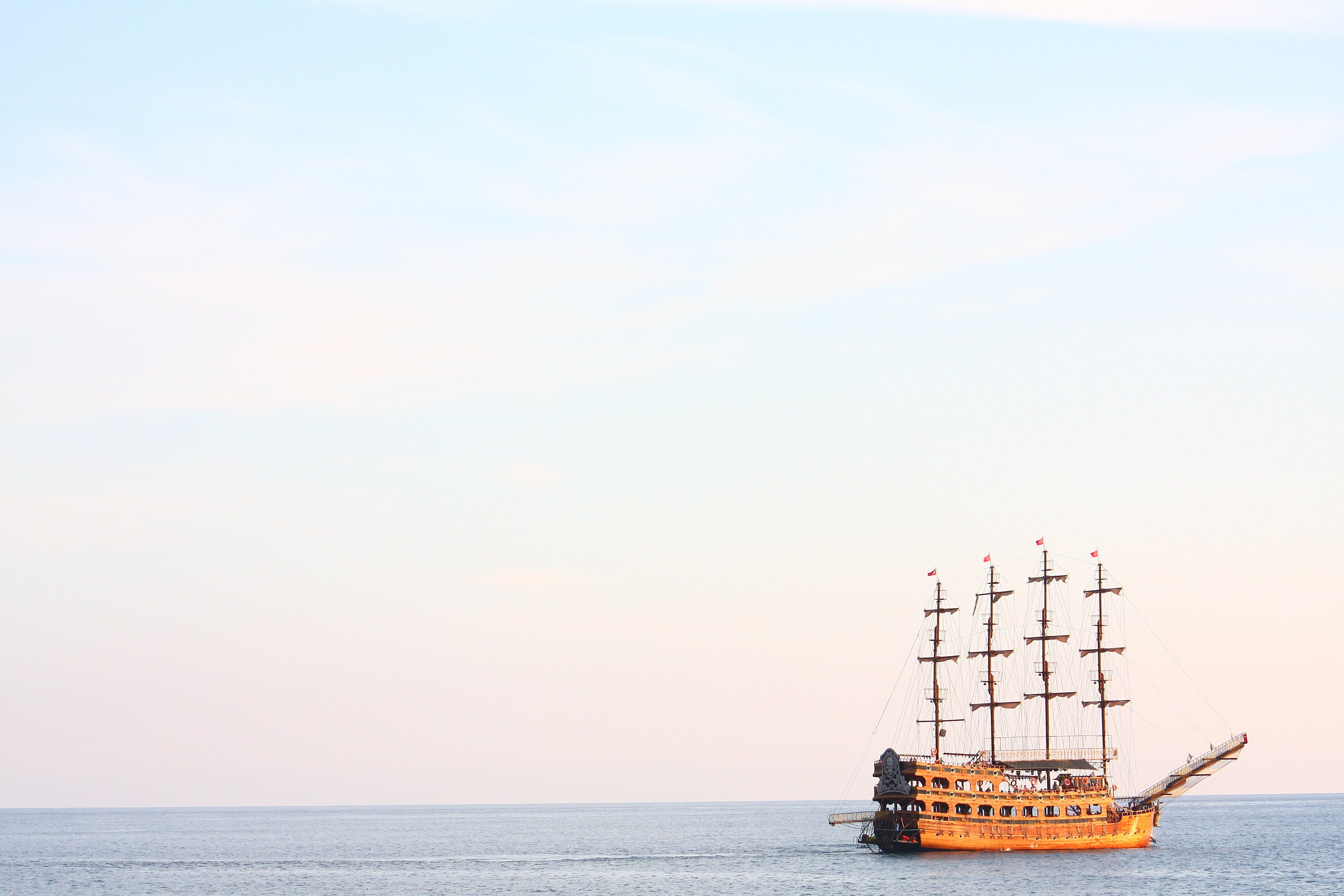 Photography of Brown Wooden Ship on Body of Water