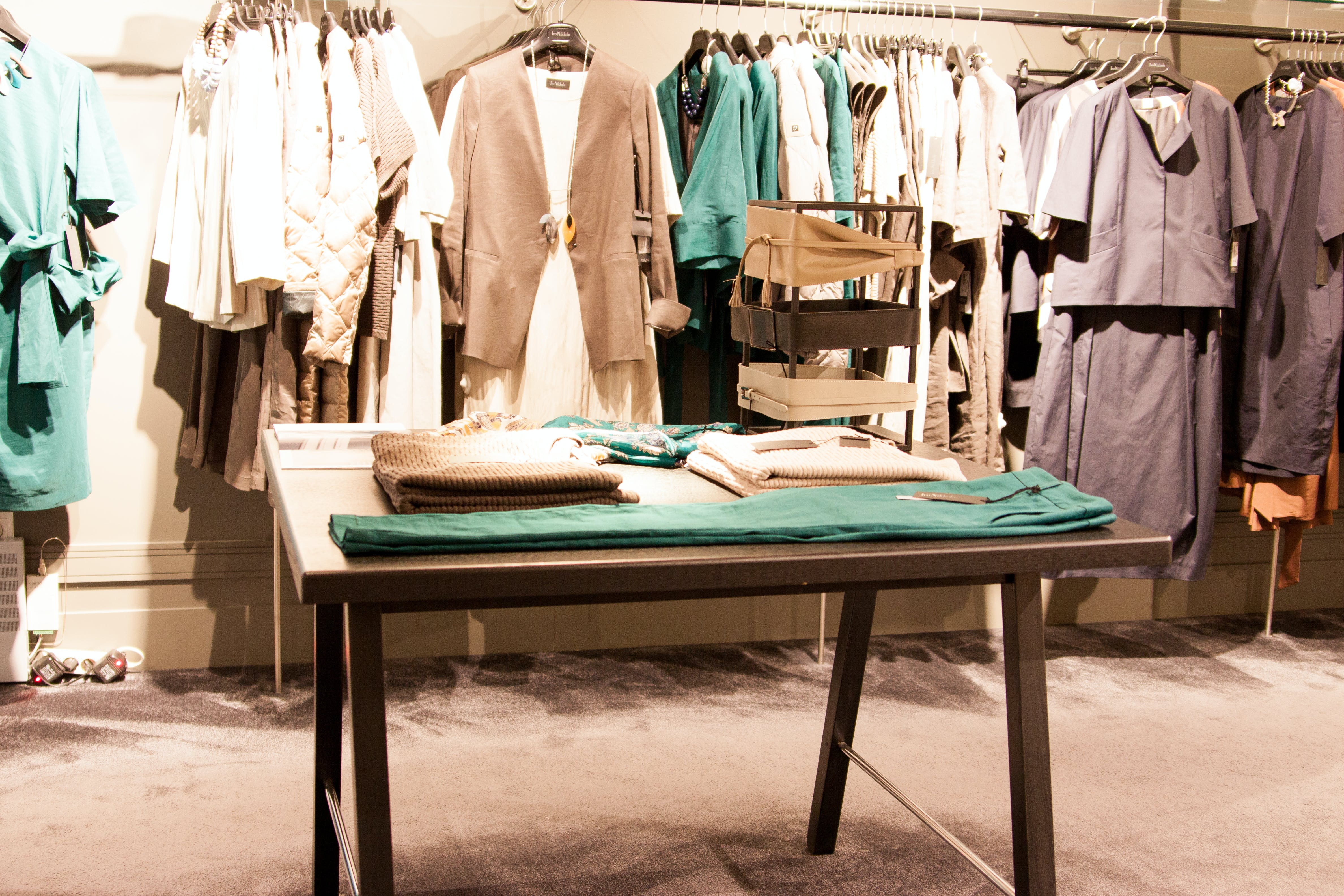 Free stock photo of clothes table, design, design space, table