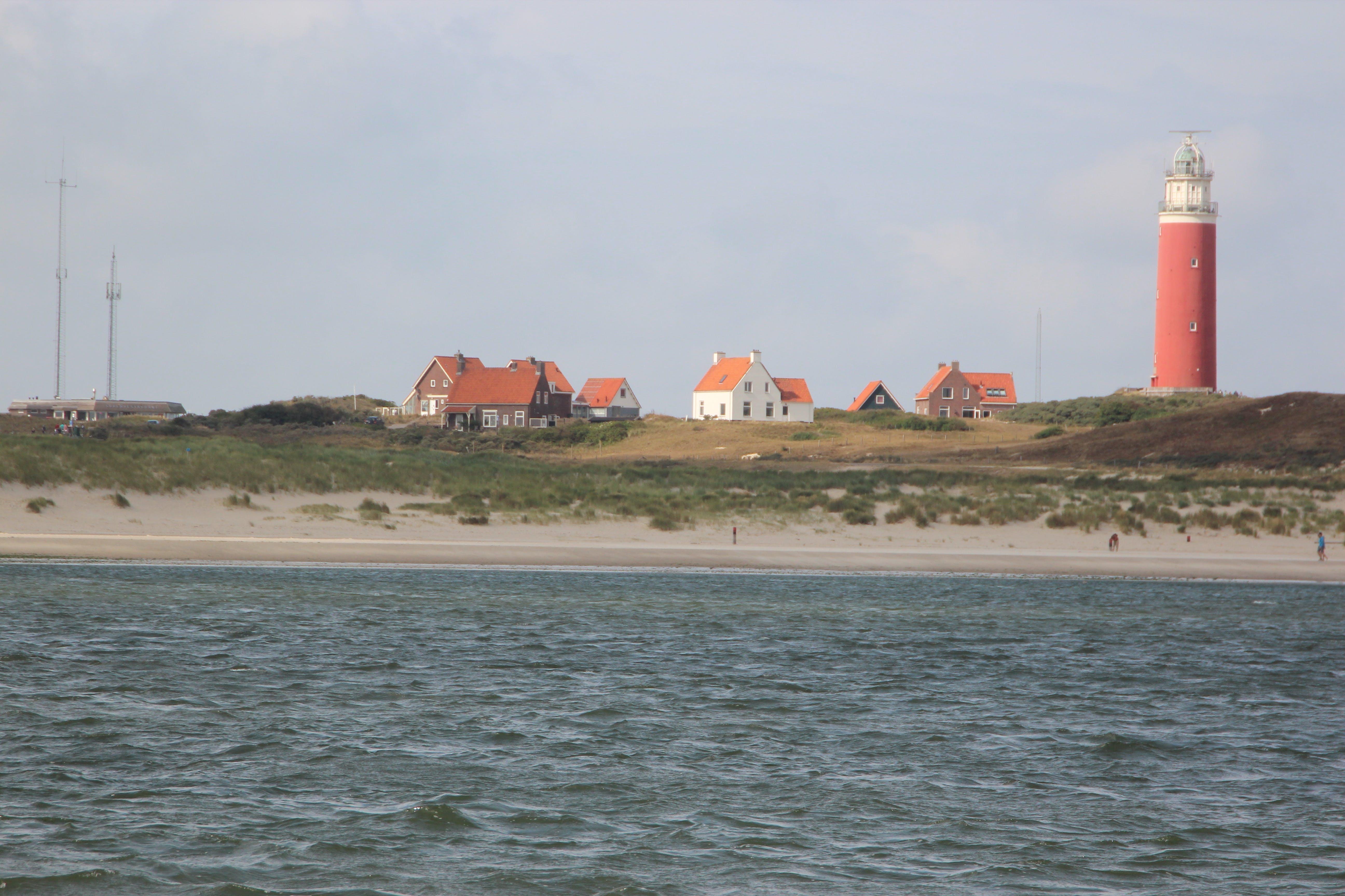 Free stock photo of blue, boat house, dunes, firetower
