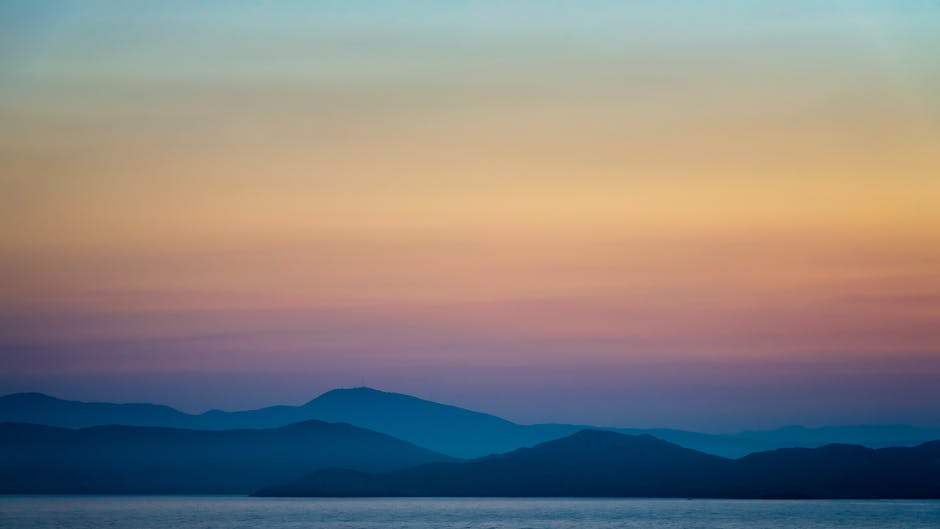 Silhouette of Mountains during Golden Hour · Free Stock Photo