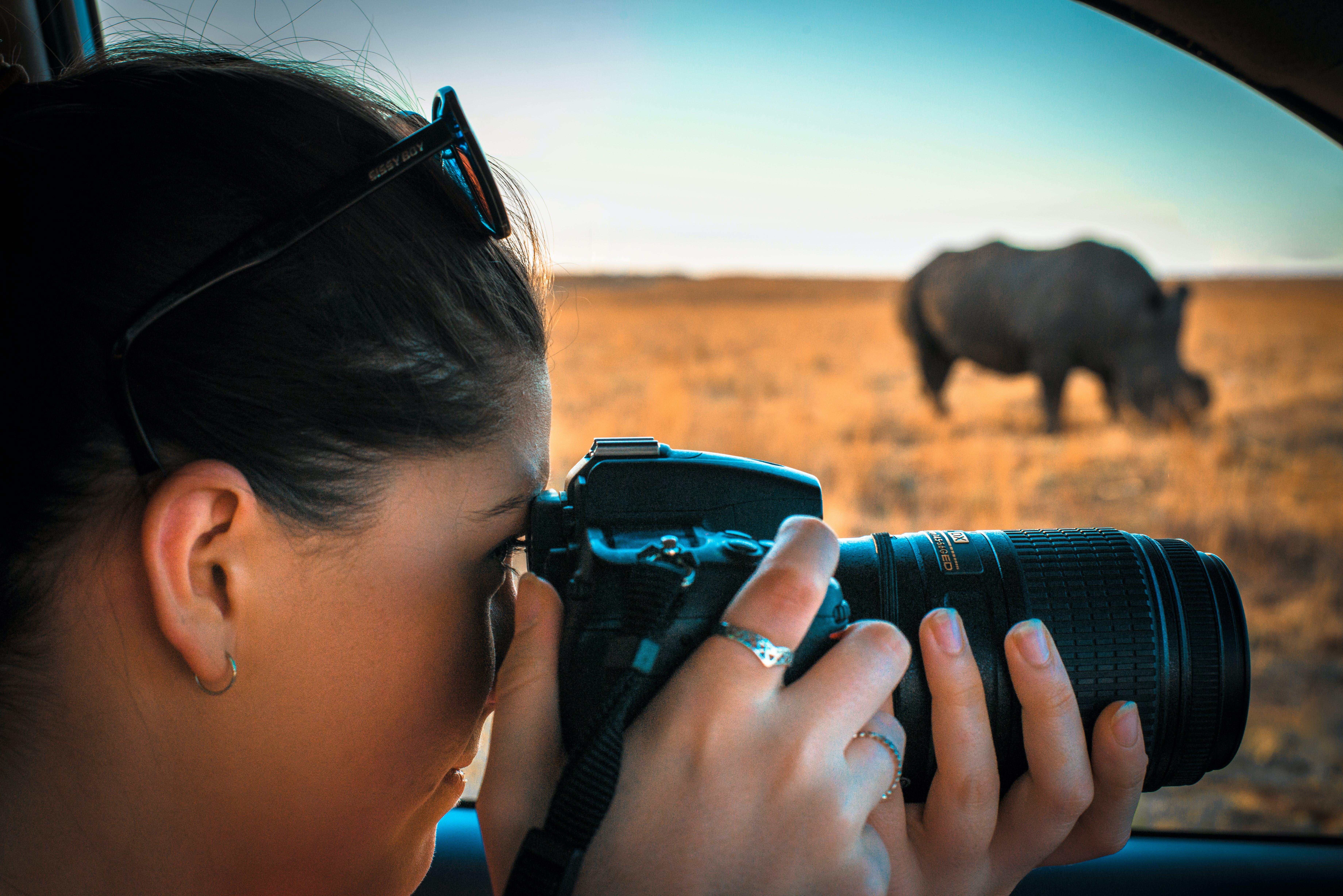 Woman Holding Black Dslr Camera