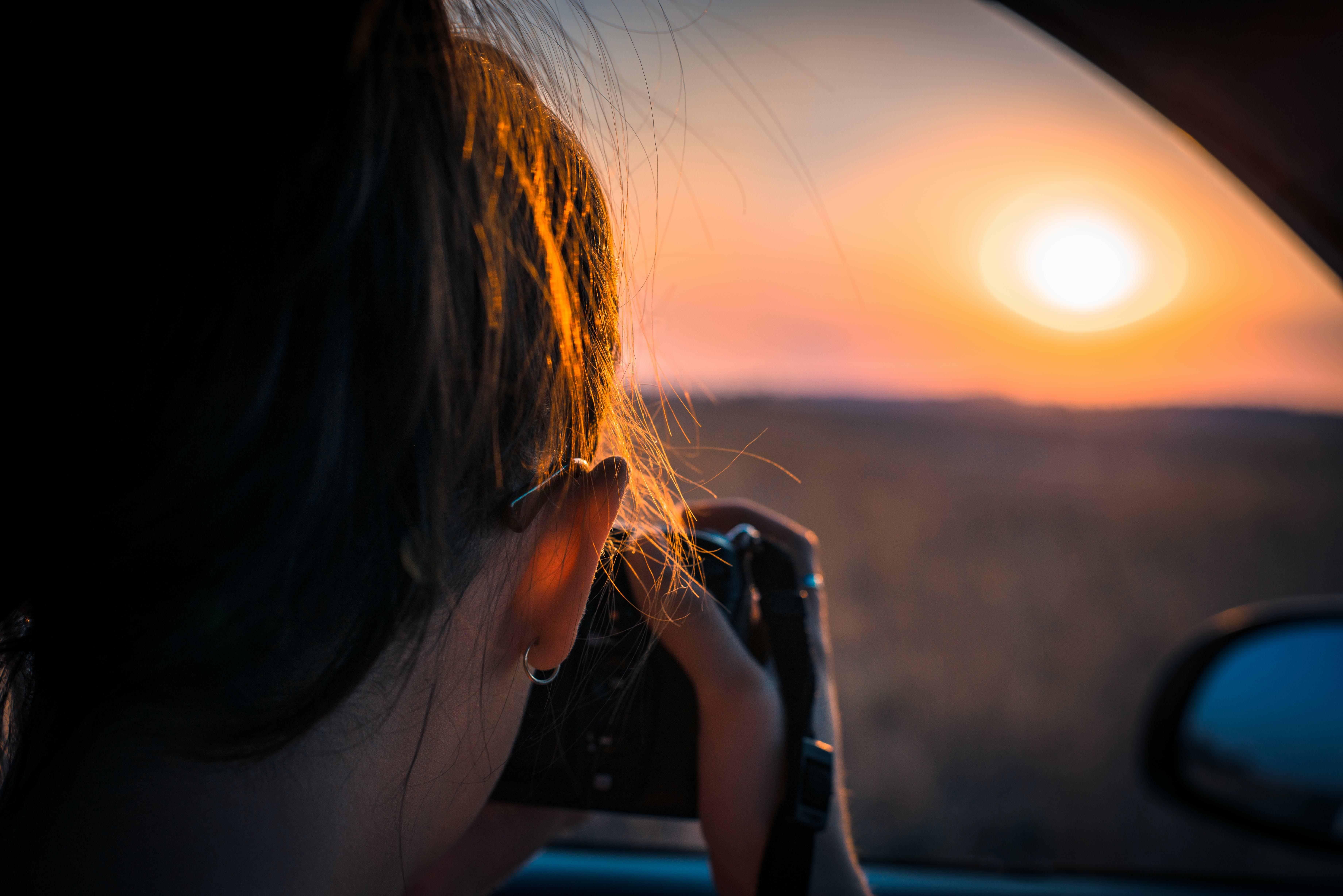 Person Taking Photo of Sun