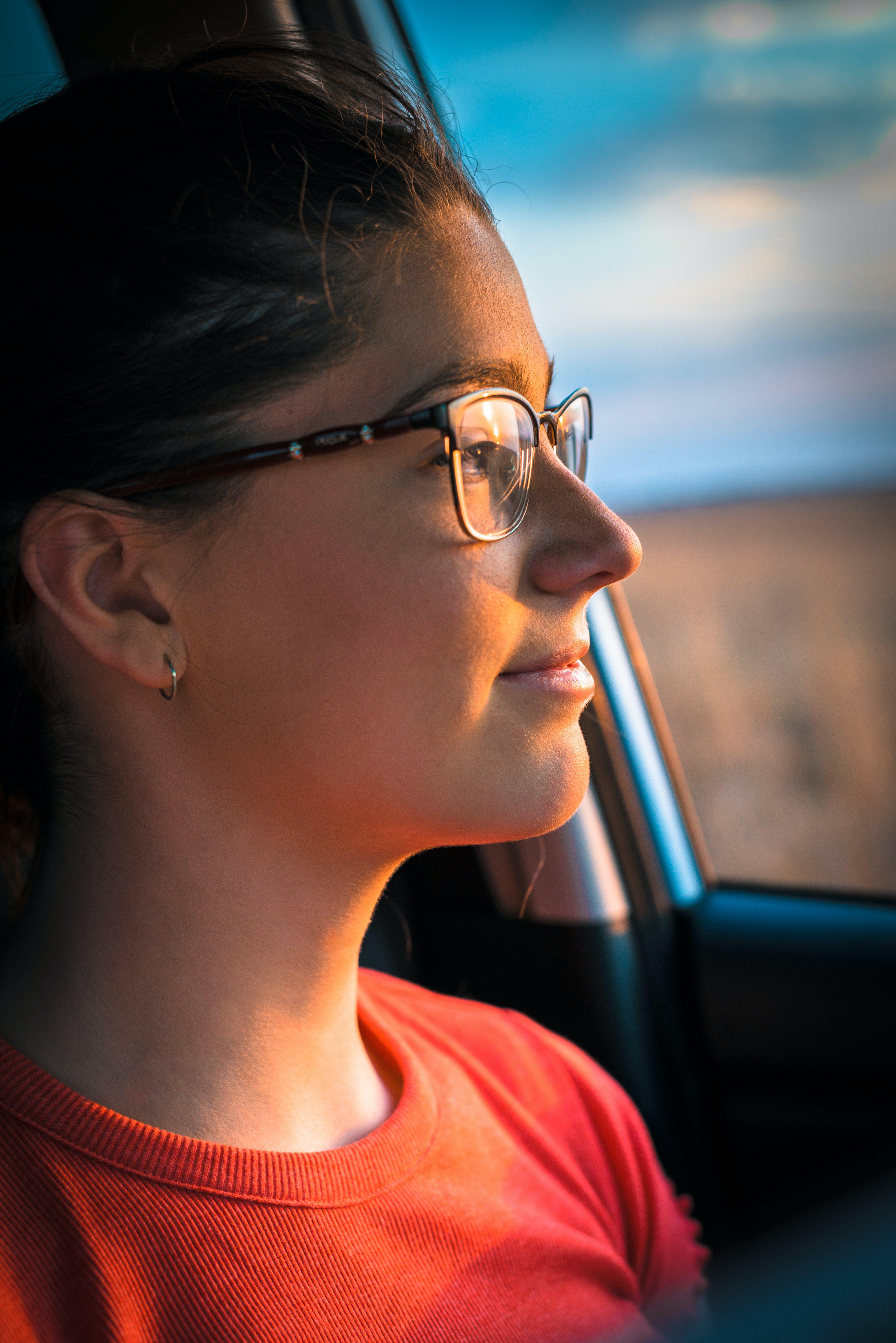 Woman in Orange Crew-neck Top Near Car Door