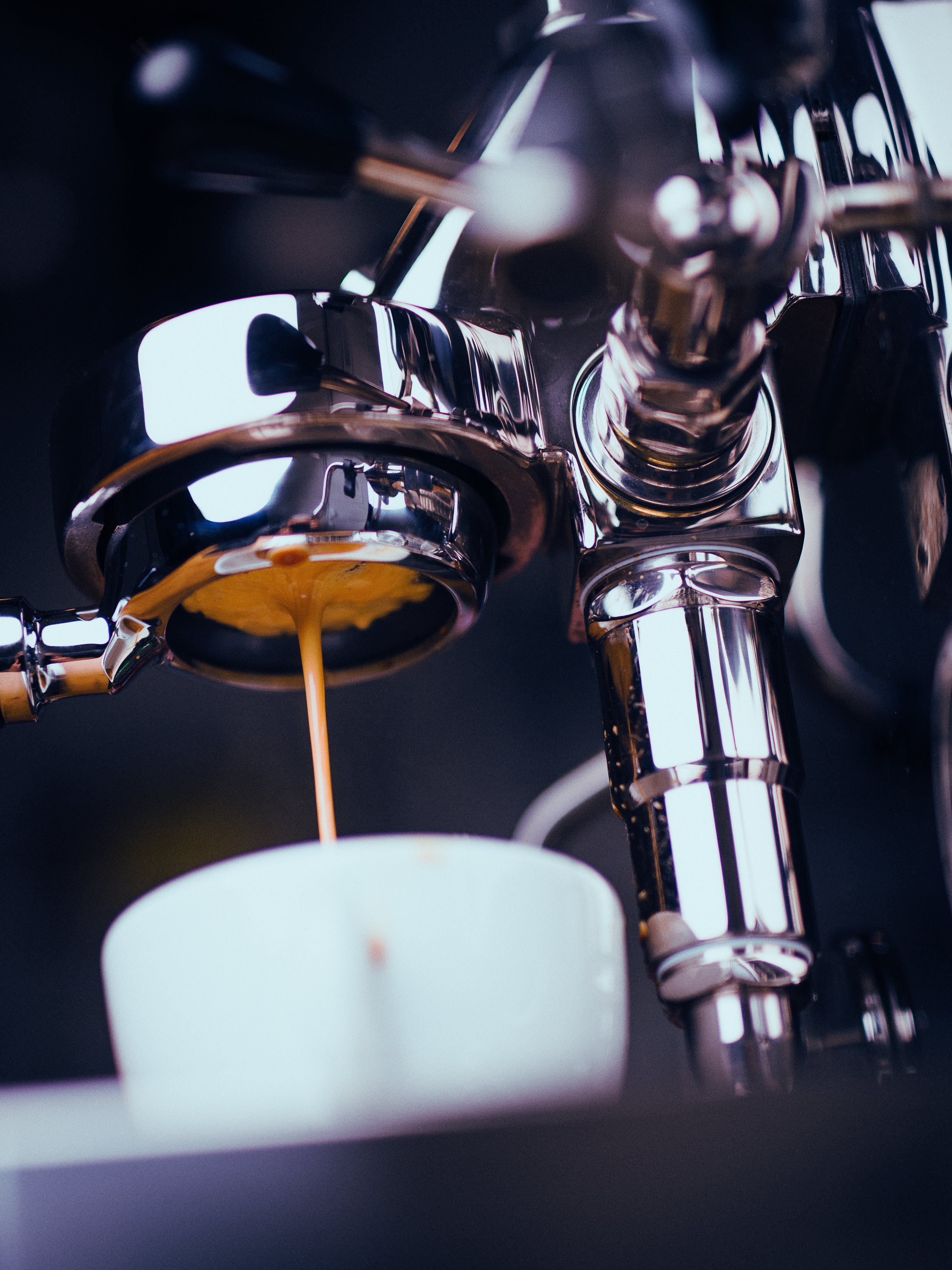 Espresso Machine Extracting Coffee and Dripping in White Cup