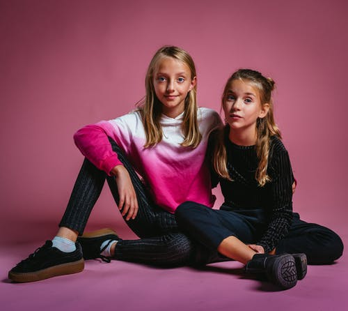 Two Girls Sitting on Floor
