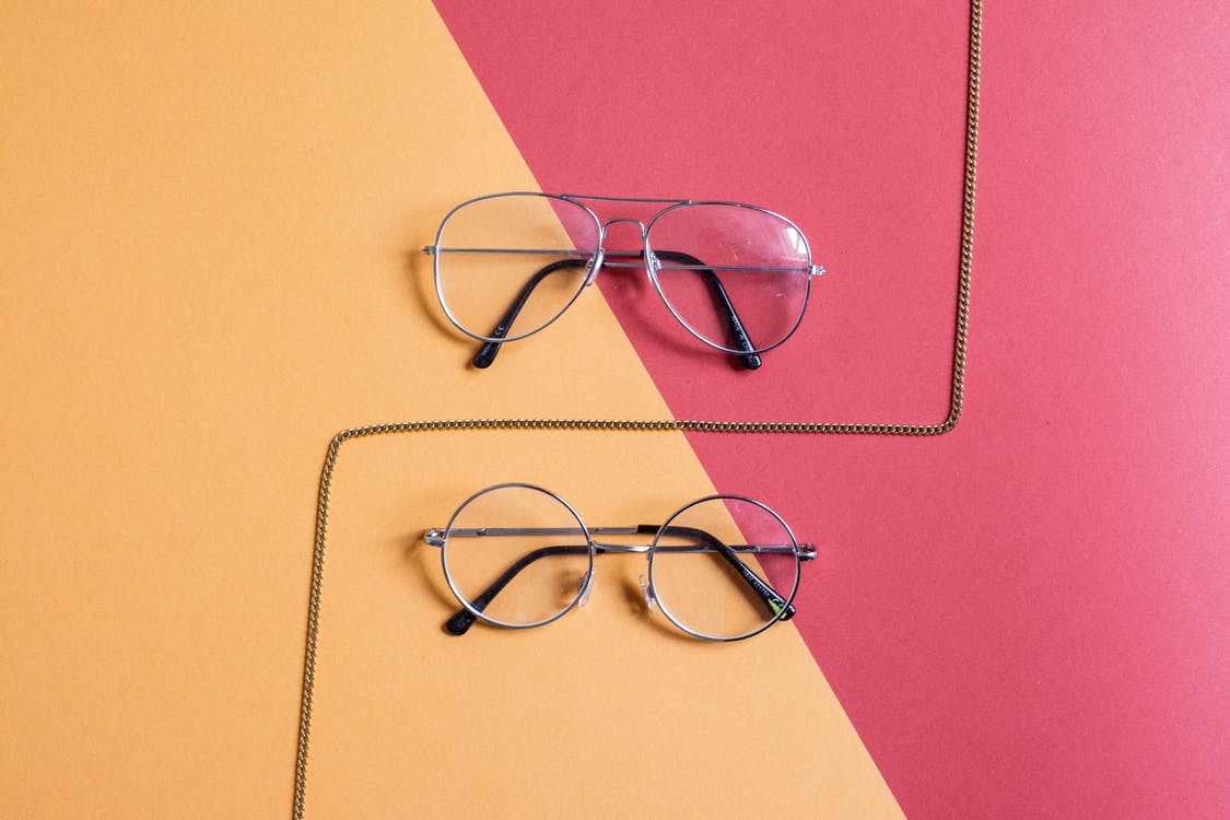 Two Clear Eyeglasses With Gray Frames