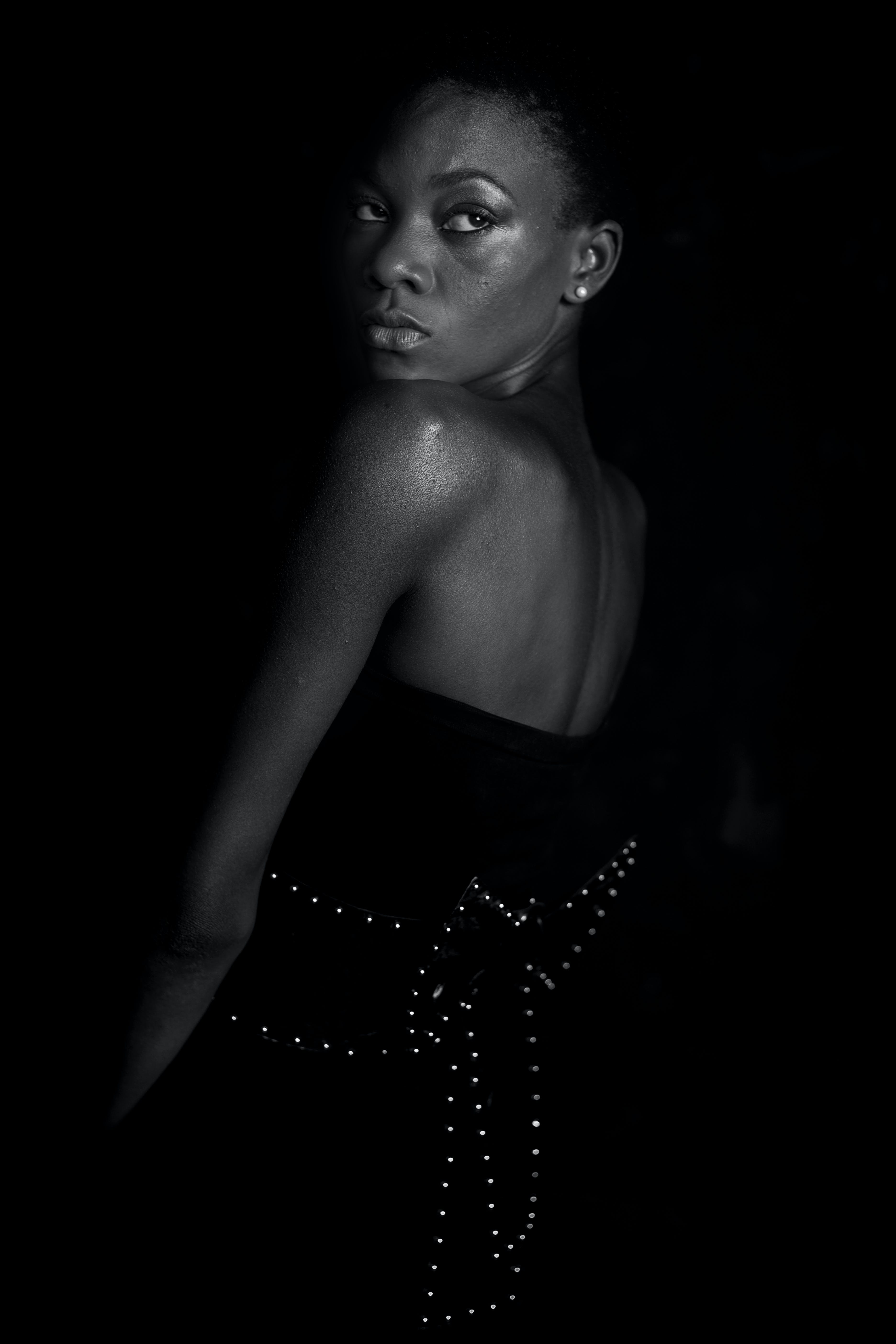 Grayscale Photography of Woman Wearing Bow-themed Dress