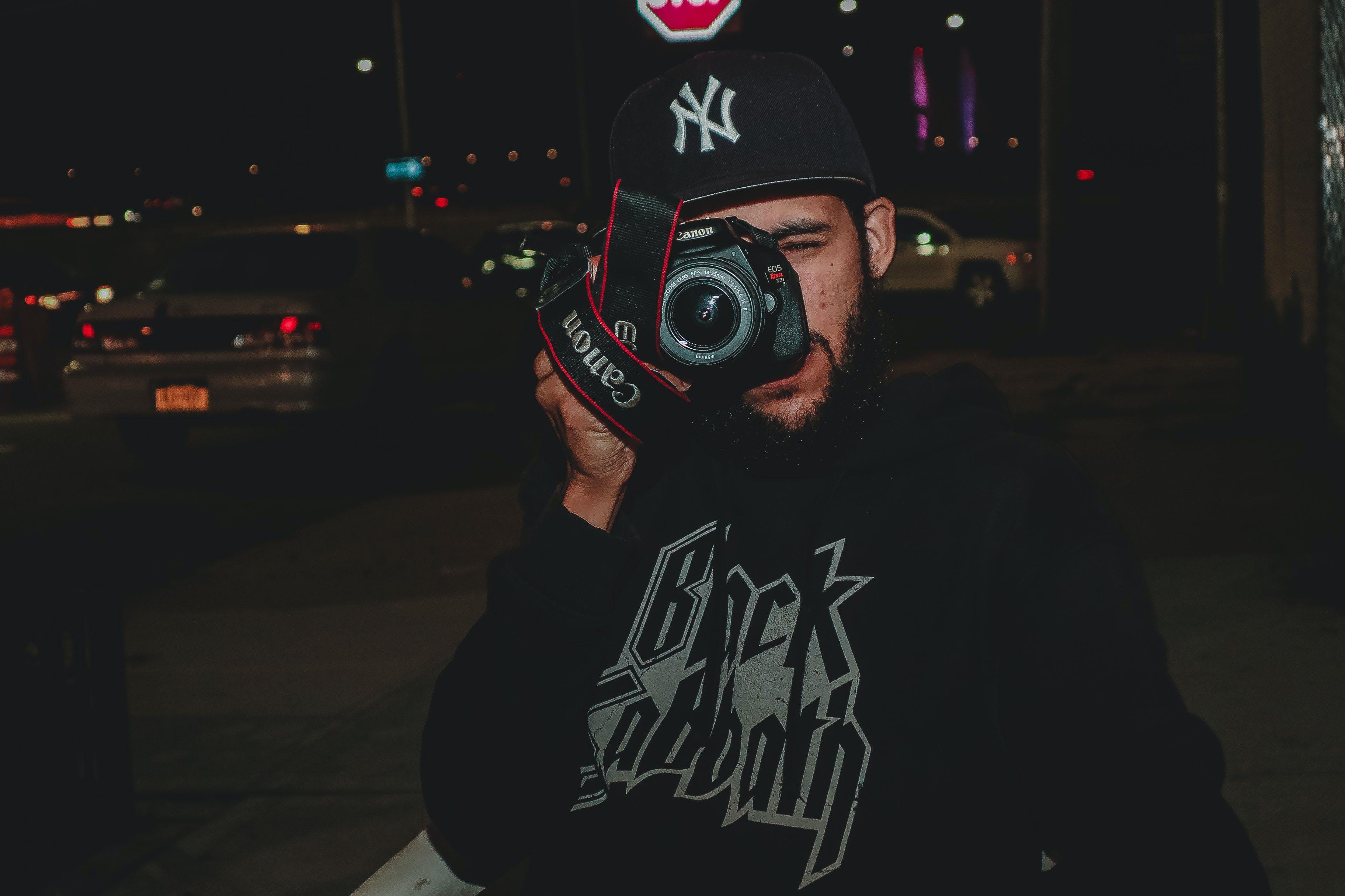 Man Taking Picture Using Canon Dslr Camera