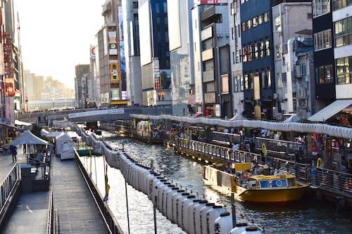 Бесплатное стоковое фото с dotonbori, вода, город, закат