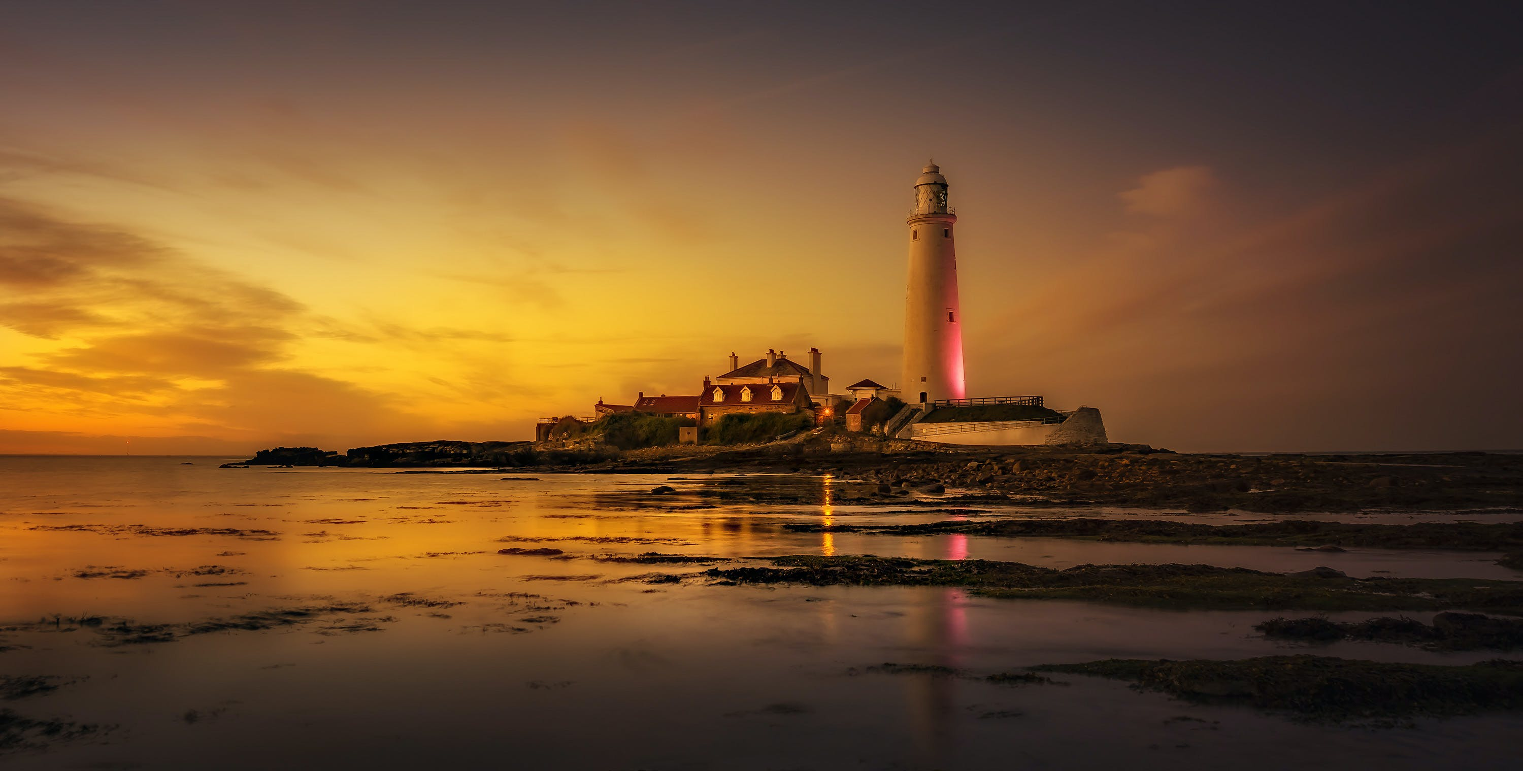 White Lighthouse Near Seashore