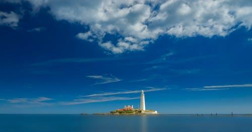 Ingyenes stockfotó ég, építészet, felhők, napfény témában