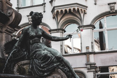 Red Rose Placed on Female Water Fountain Statue's Hand