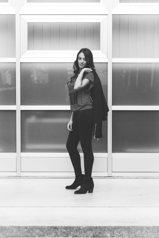 Monochrome Photo of a Woman Standing