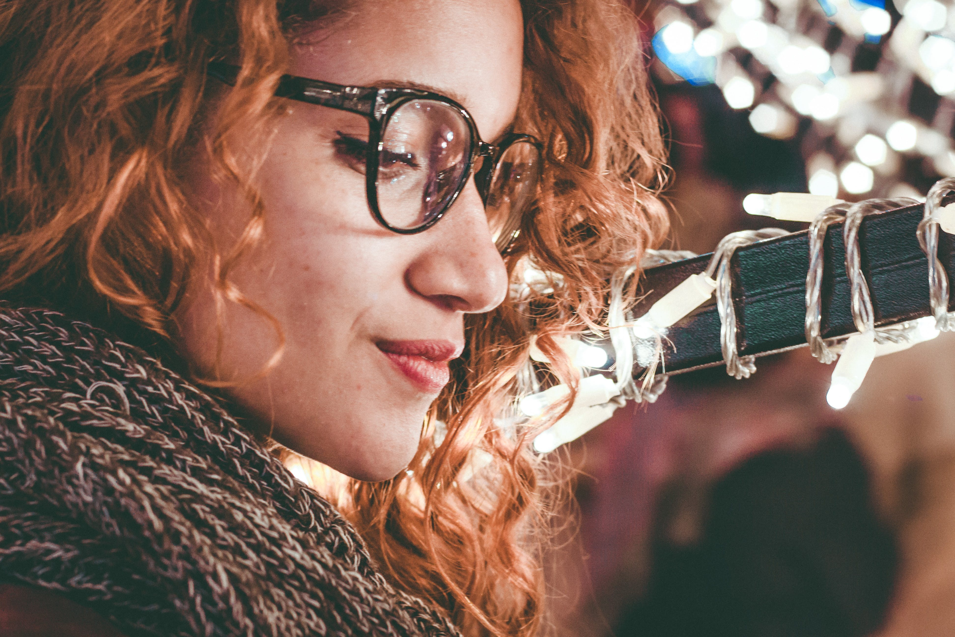 Close-Up Photo of a Woman Wearing Eyeglasses