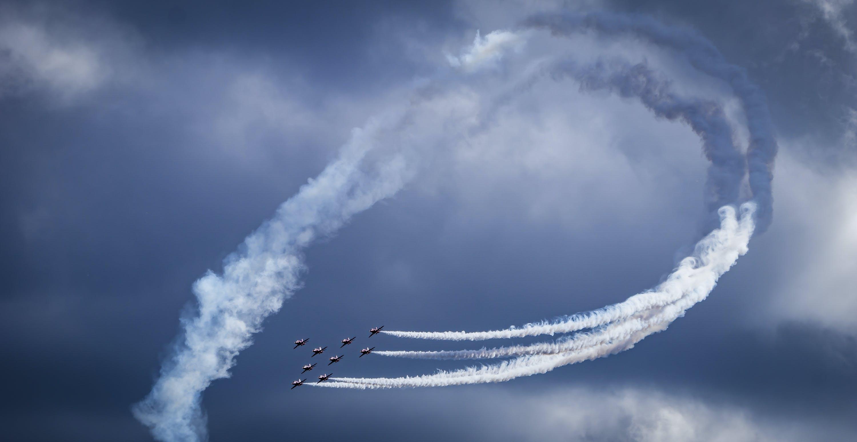 Photo of Airplanes Performing Aerobatics