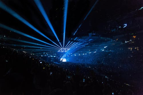 People on Arena With Lighted Stage