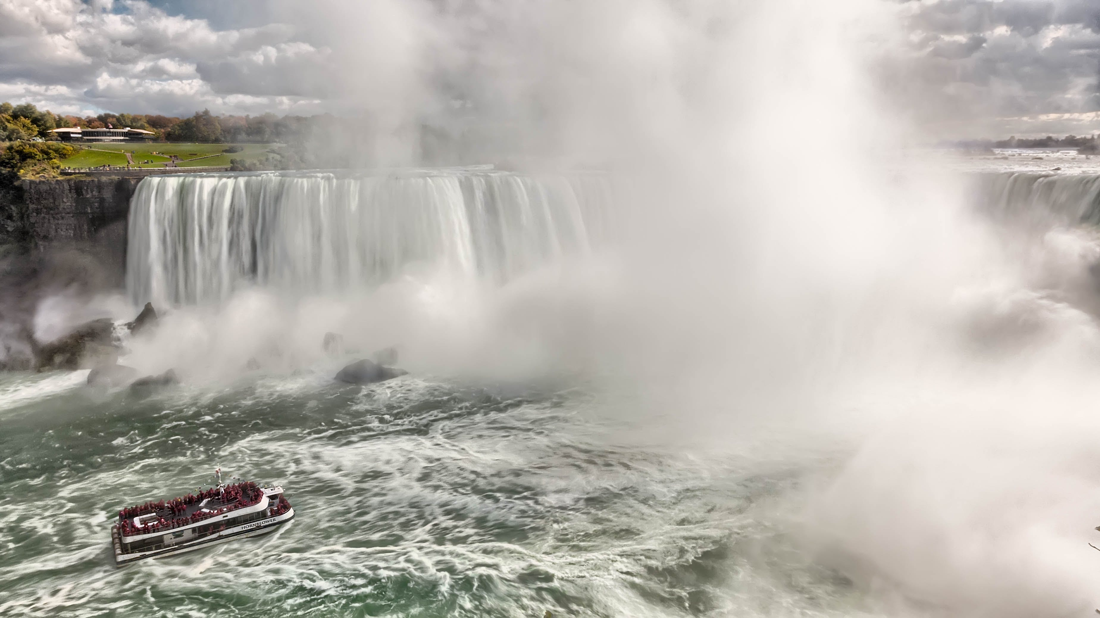 Boat Near Waterfalls during Daytime