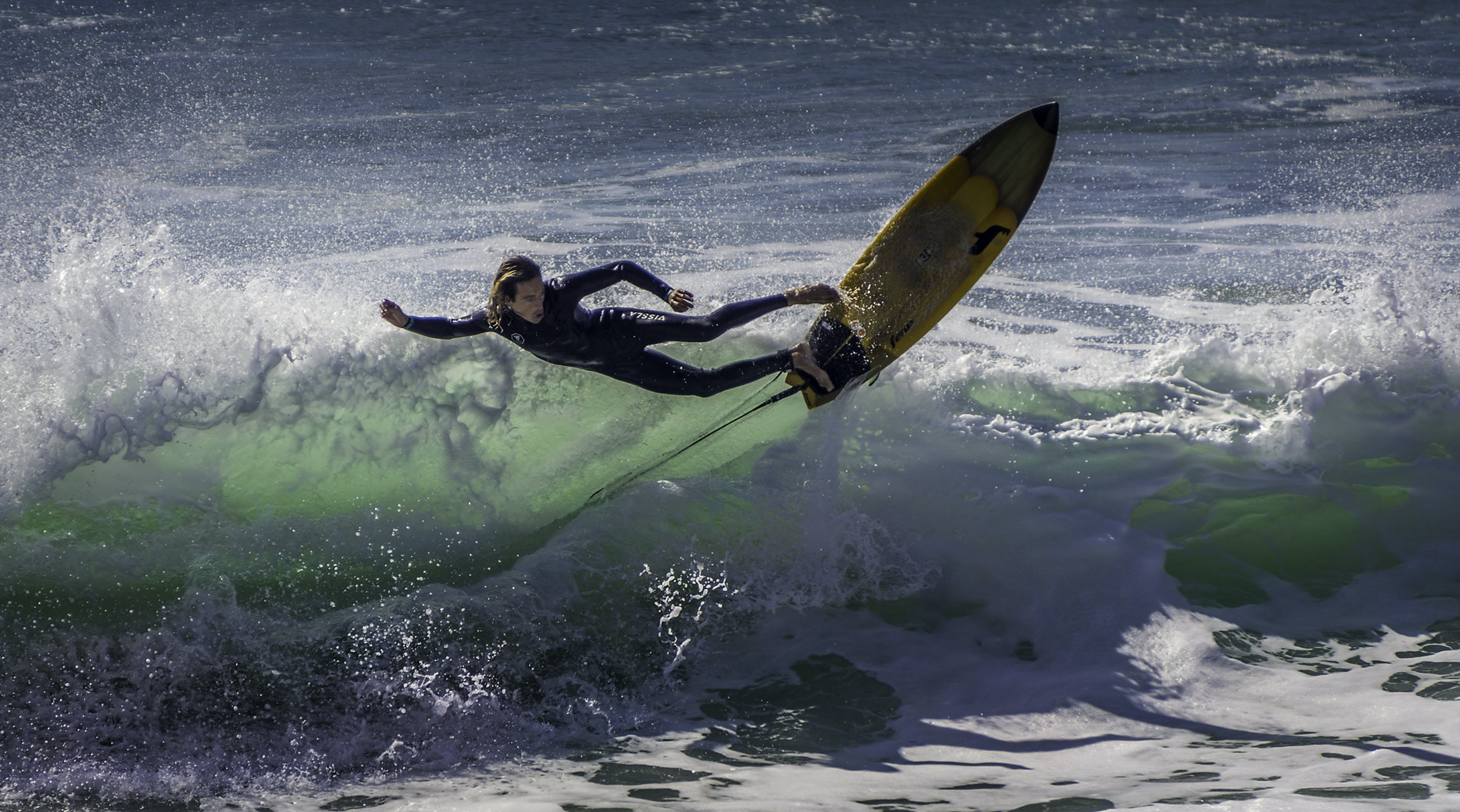 Photograph of a Person Surfing