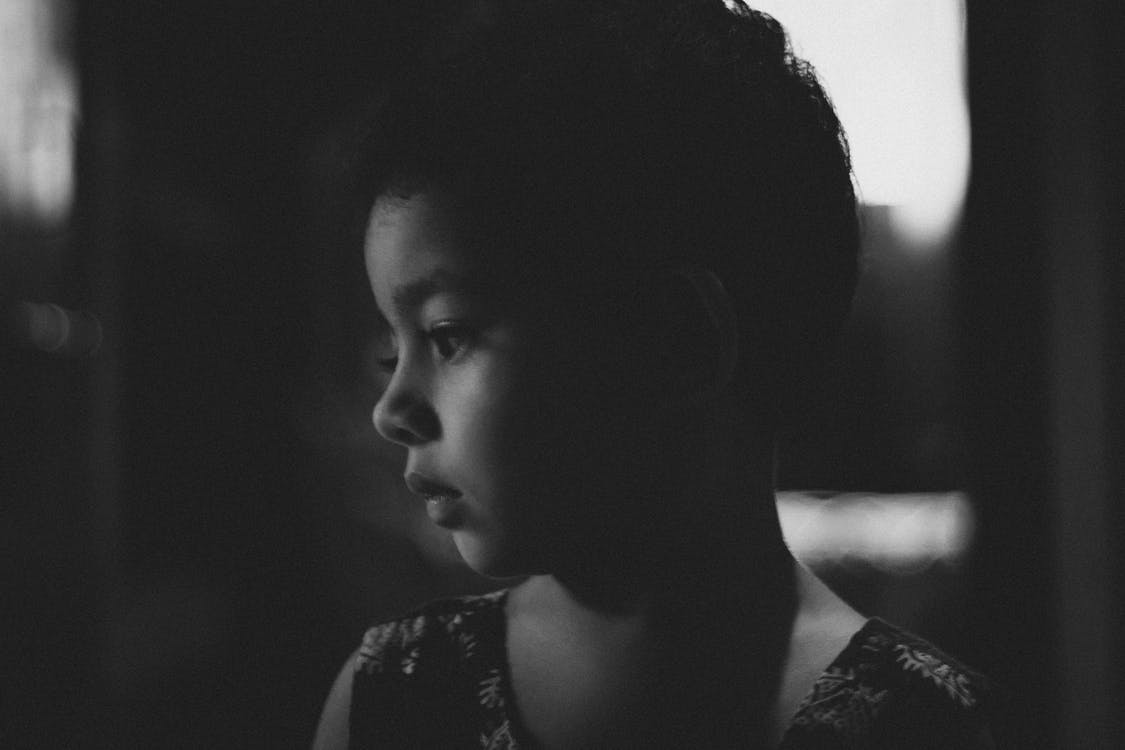 Grayscale Photo of a Boy
