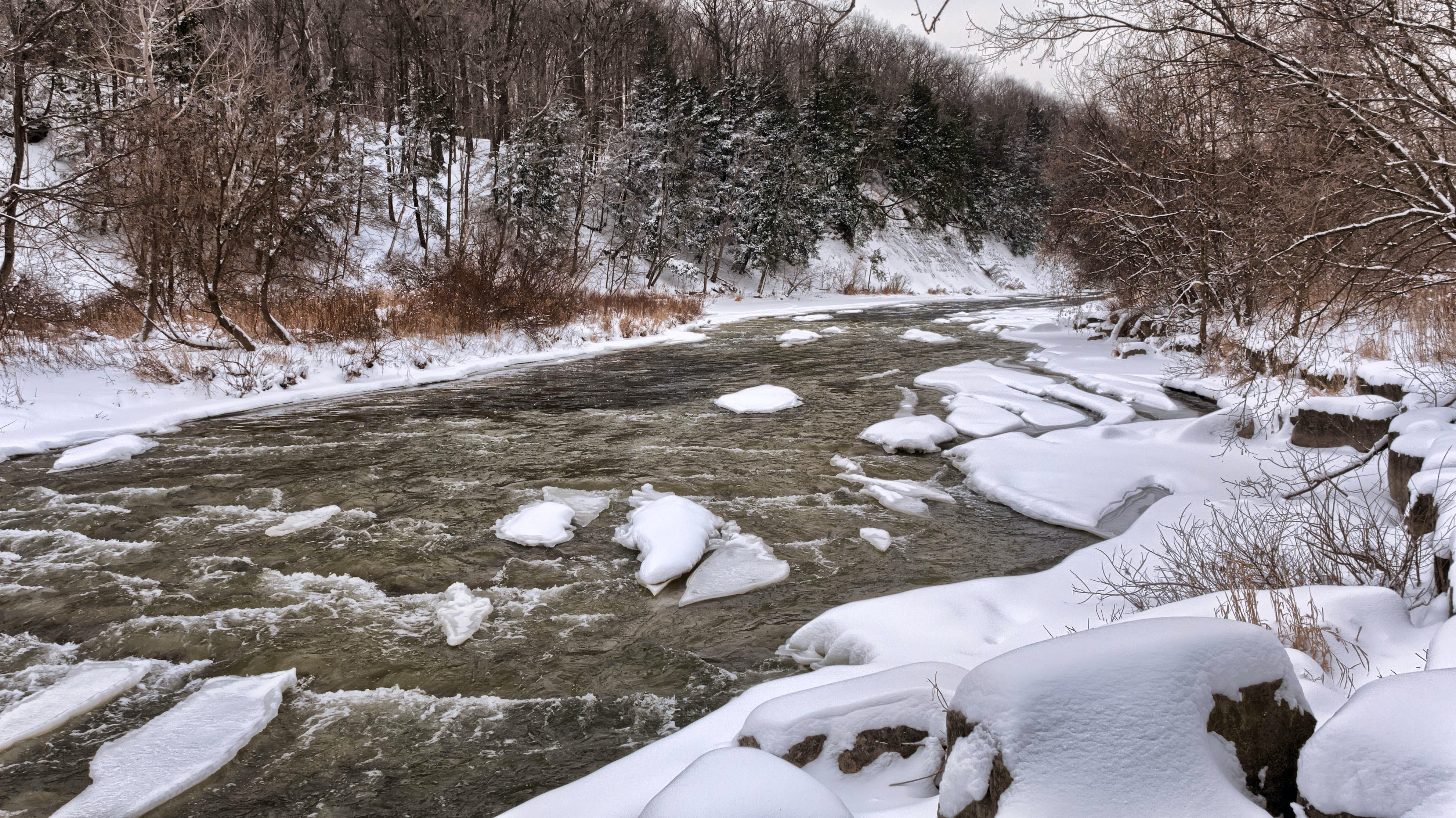 River Beside White Snow during Daytime
