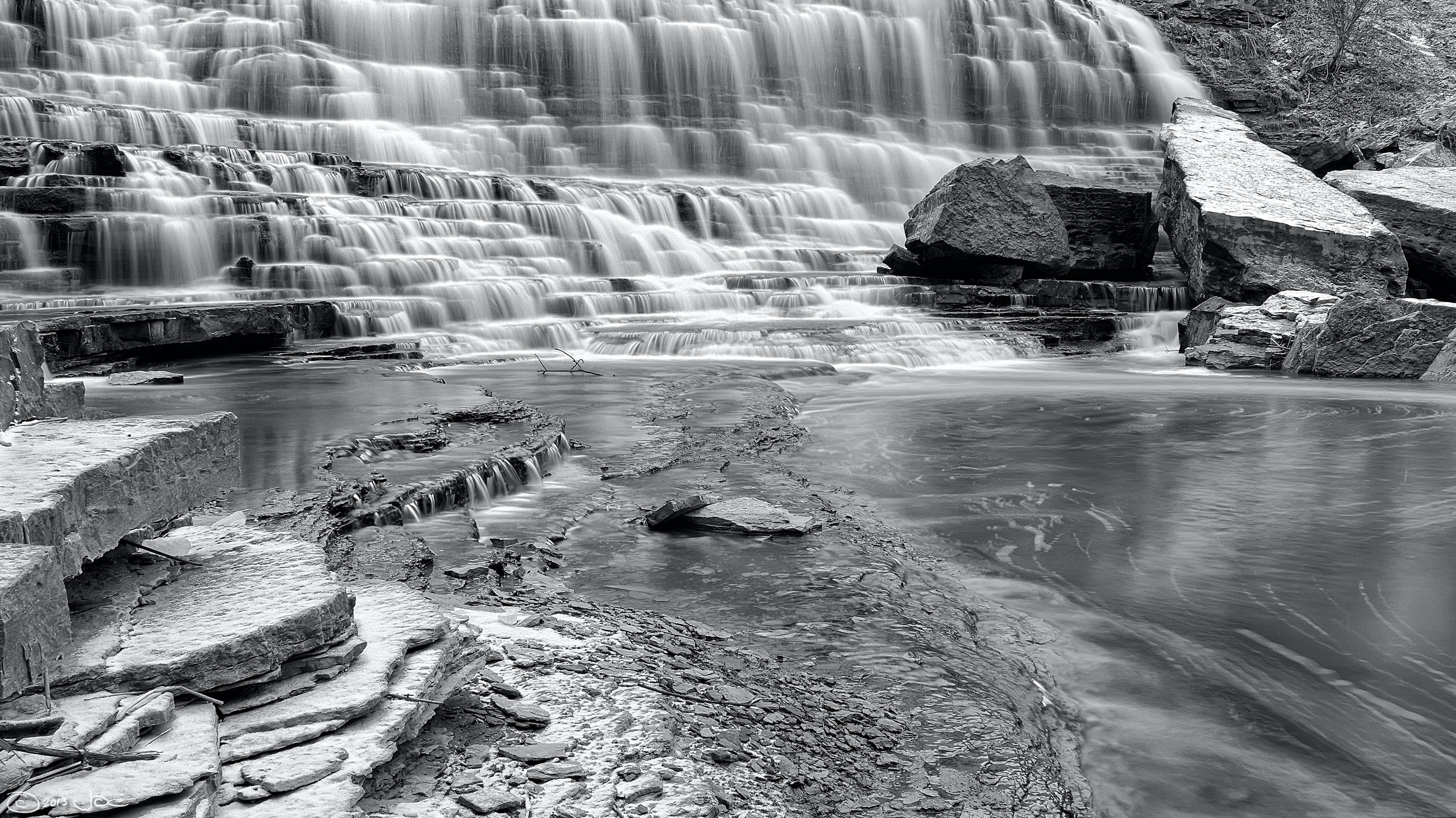 Grayscale Time Lapse Photo of Waterfalls