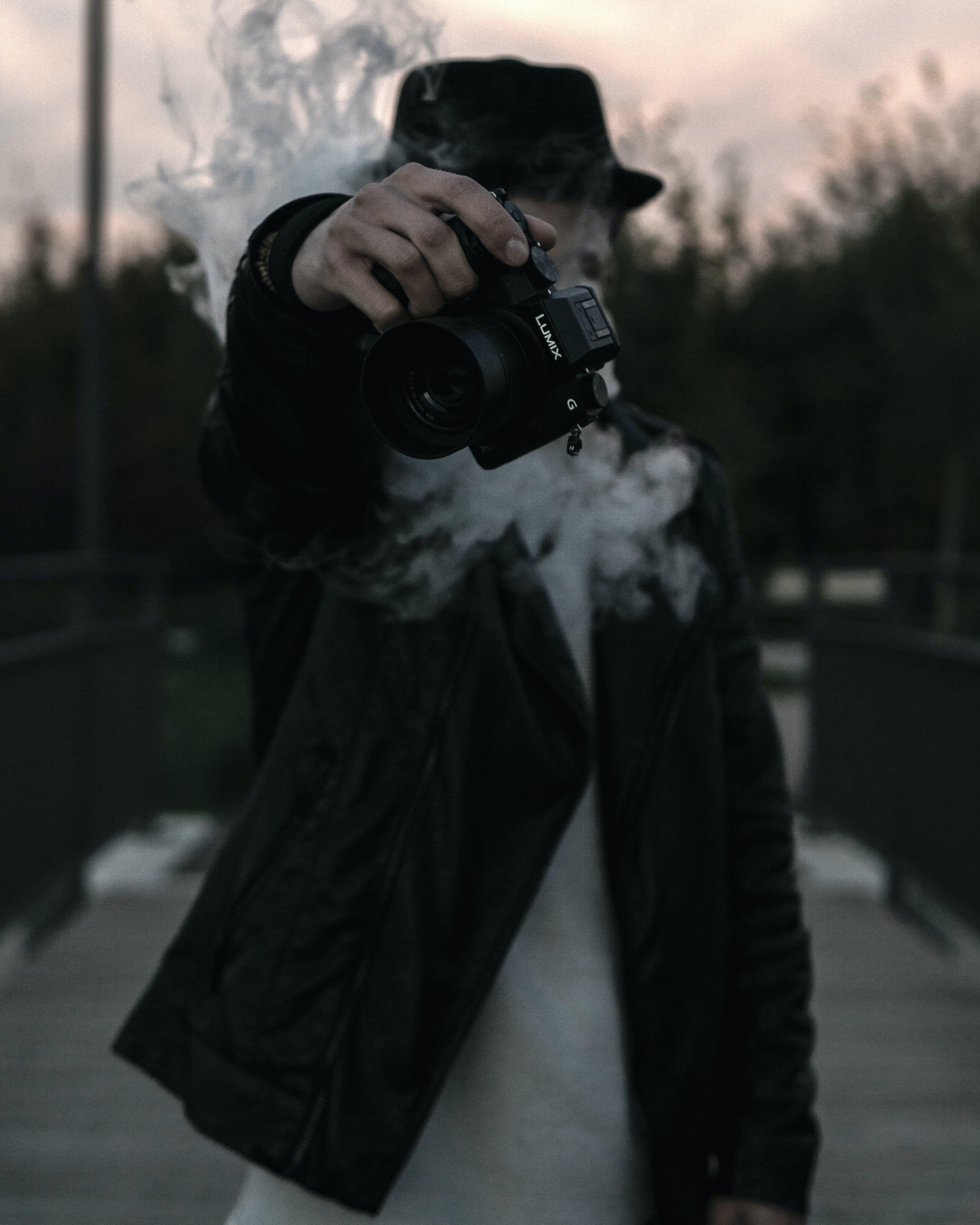 Person Black Holding Lumix Dslr Camera