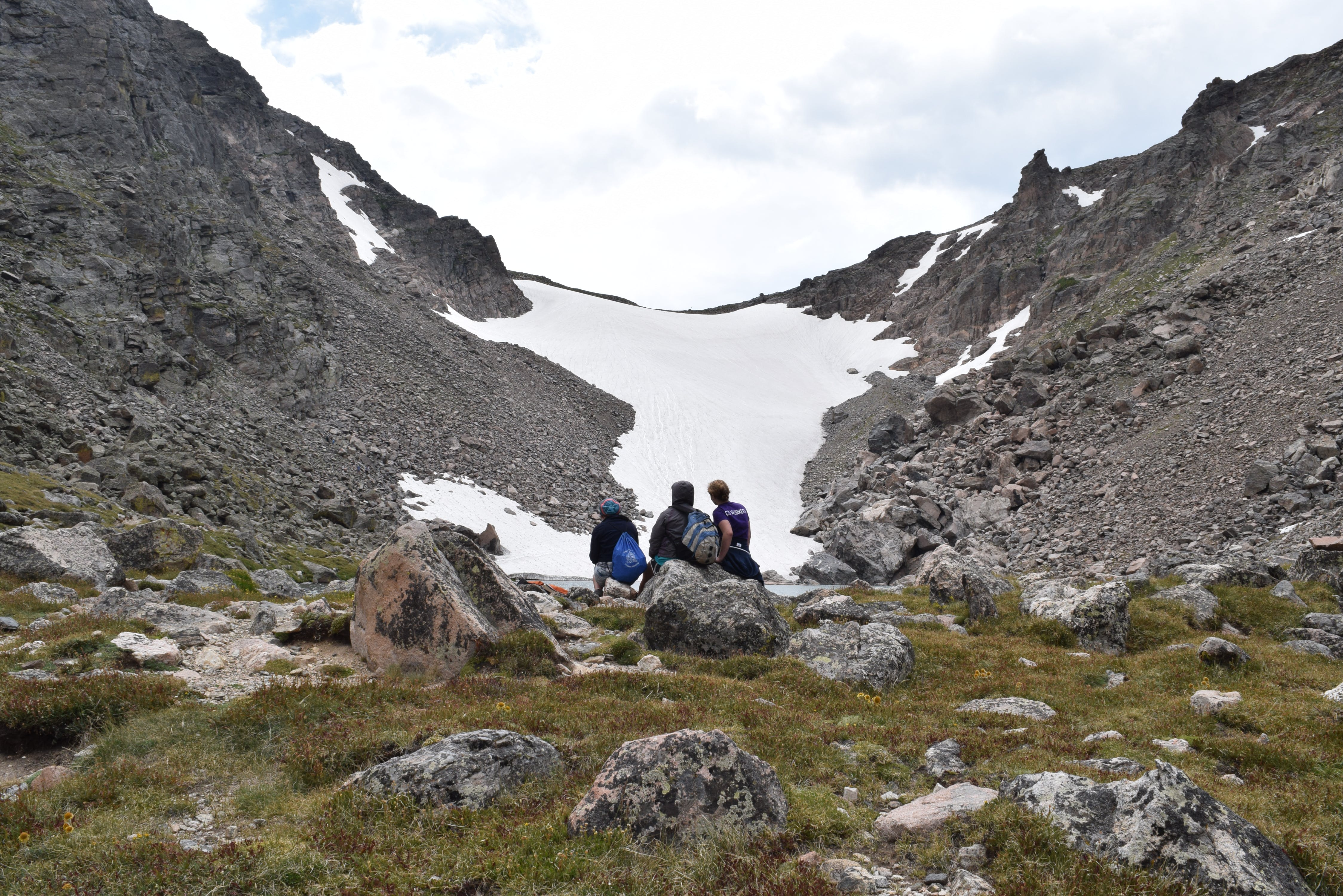 Three People Facing Snowfield