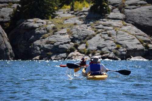 Photo of People in Kayak on a Sunny Day