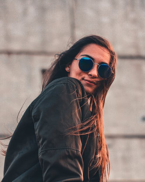 Selective Focus Photography of Woman Wearing Jacket and Sunglasses