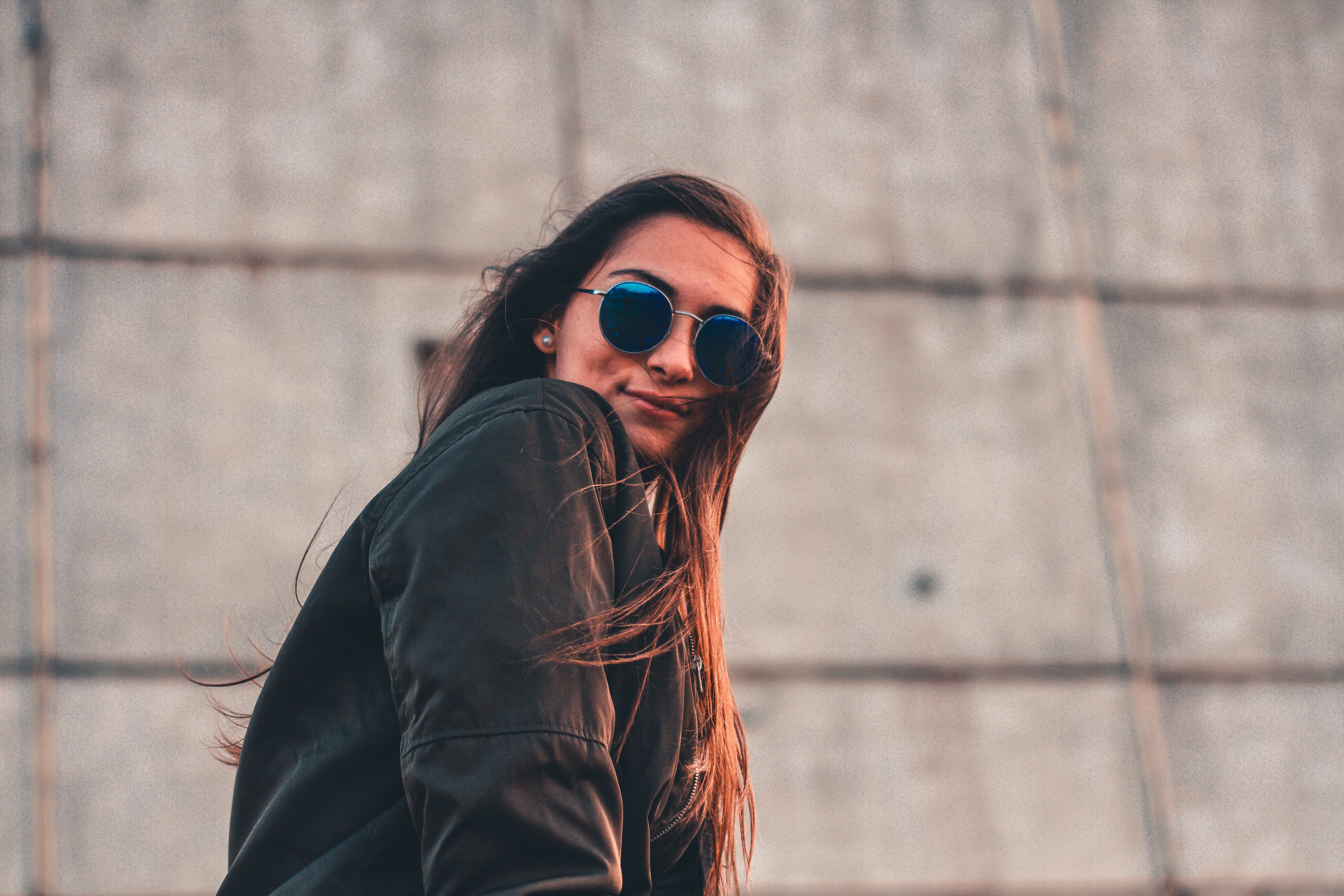 Woman in Black Jacket Wearing Sunglasses