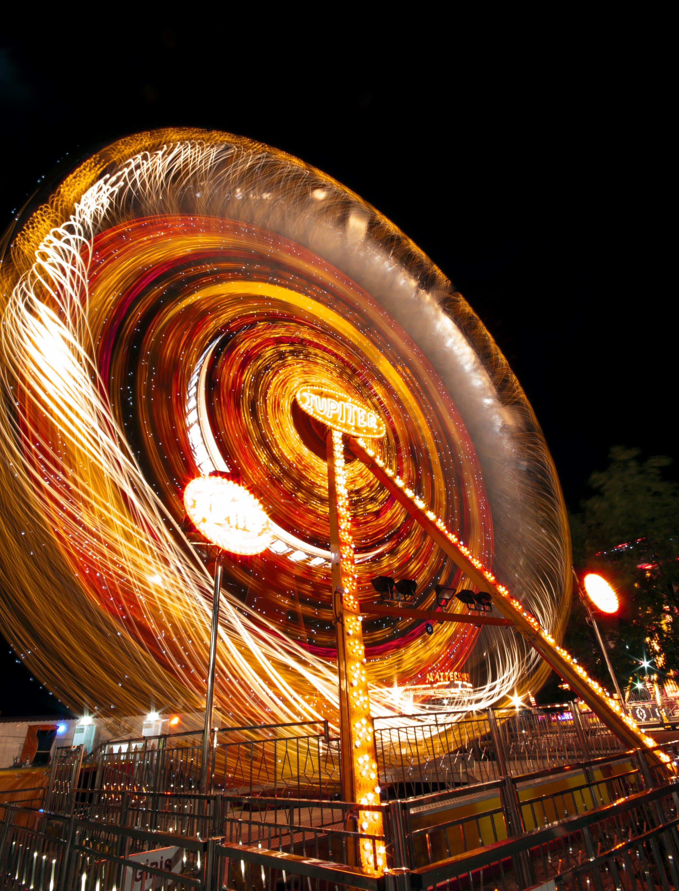 Gratis stockfoto met attractiepark, avond, belicht, beweging
