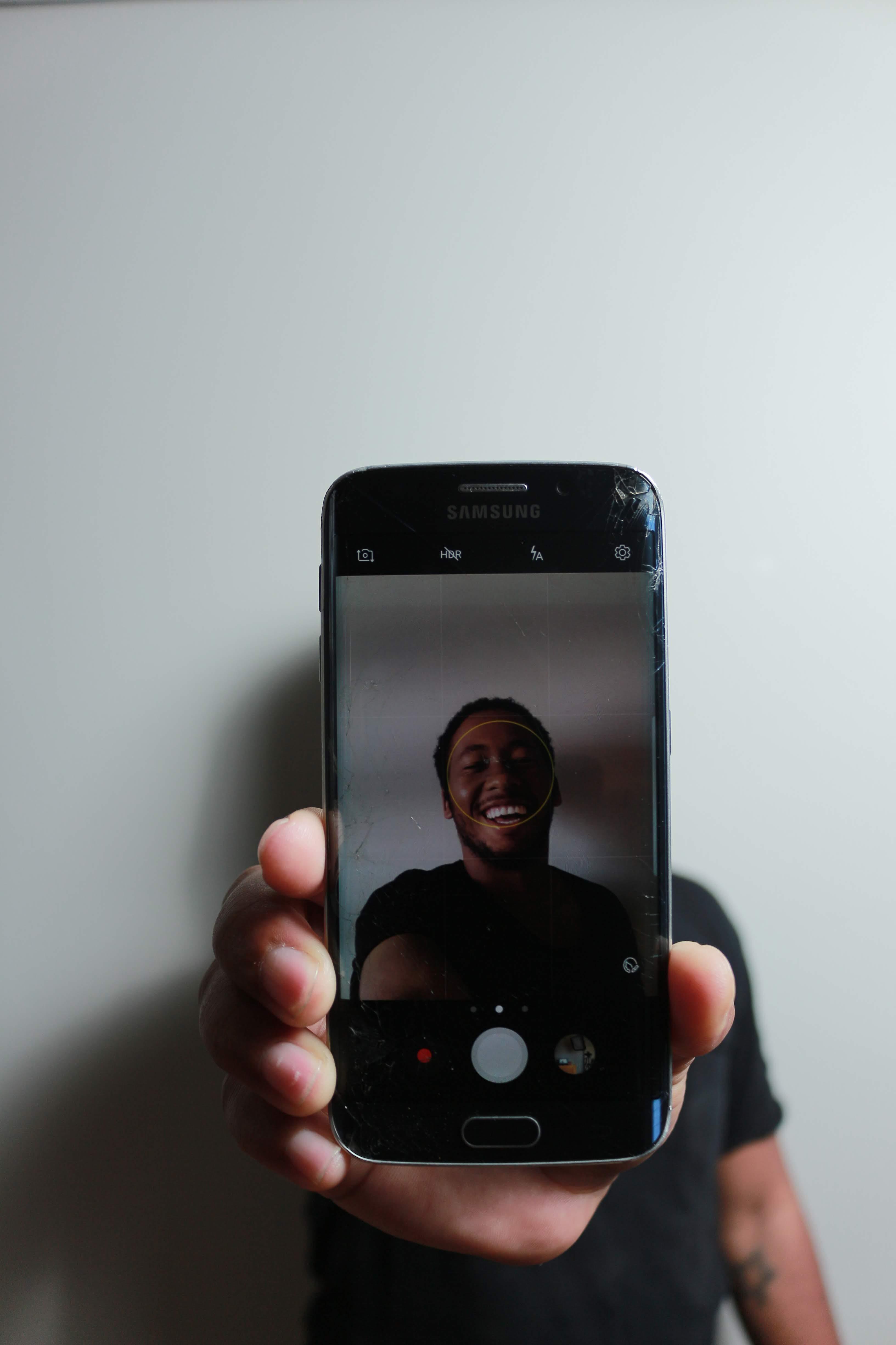 Person Taking Selfie Using Black Sapphire Samsung Galaxy S6 Edge