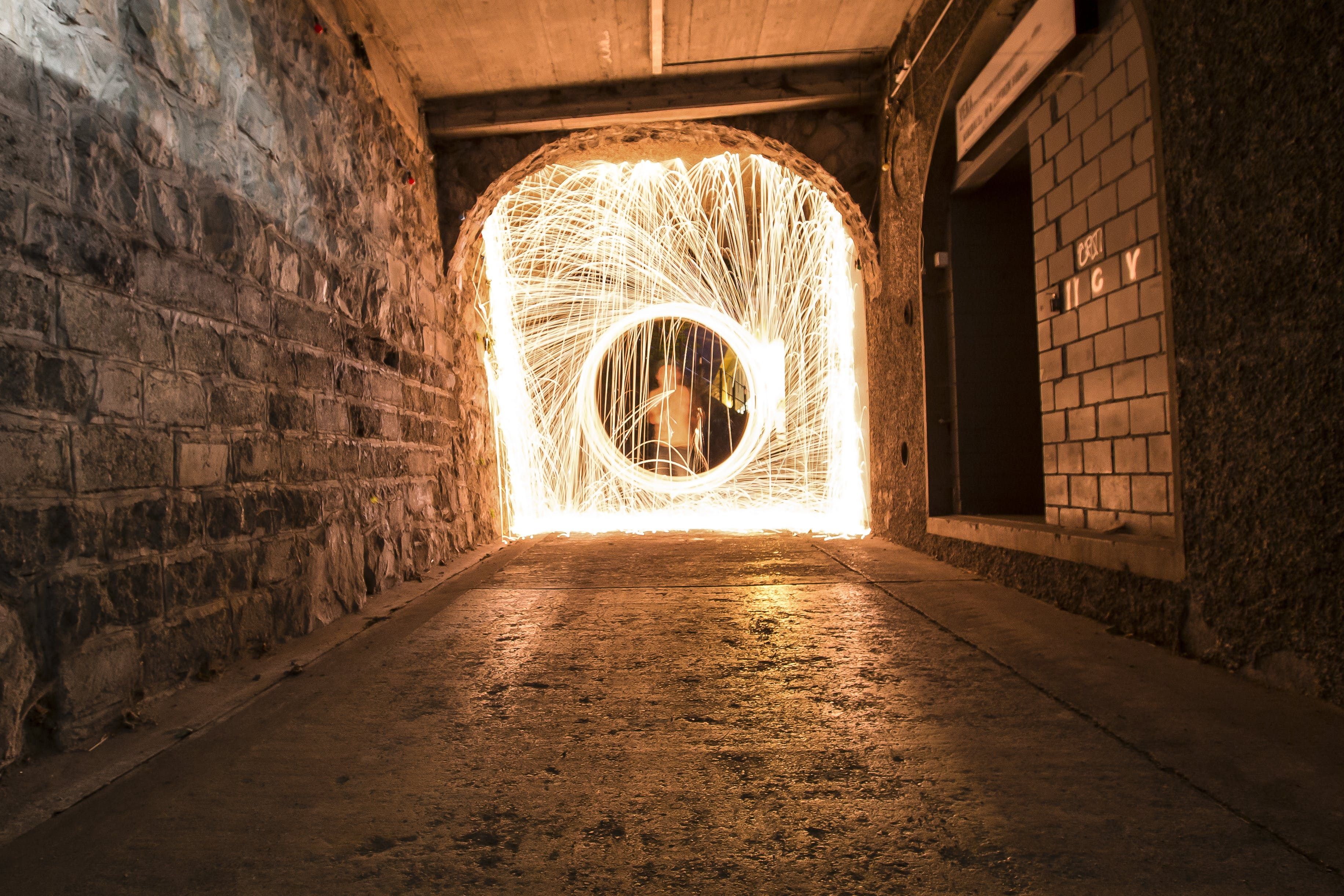 Timelapse Photo of Man in Hallway With Light
