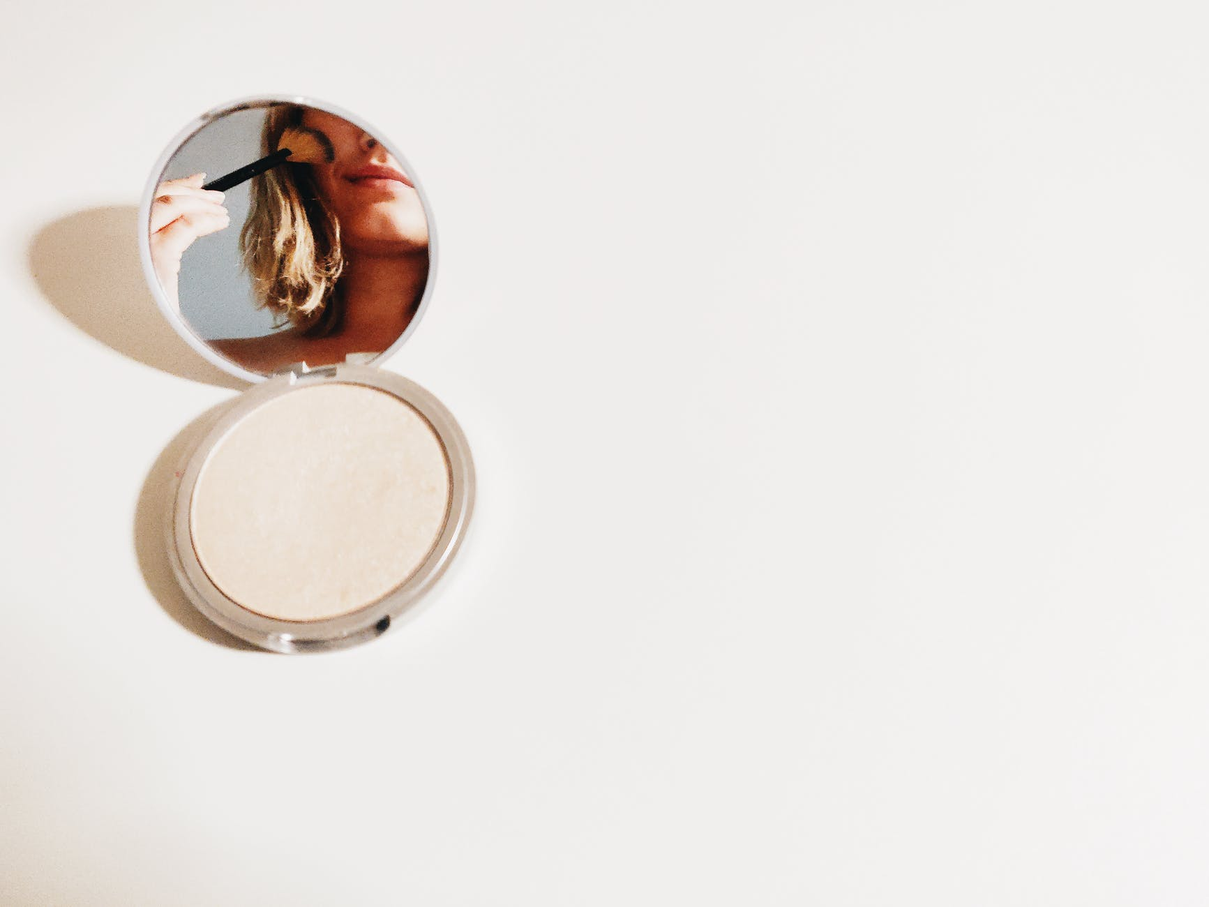 woman in the mirror using a brush