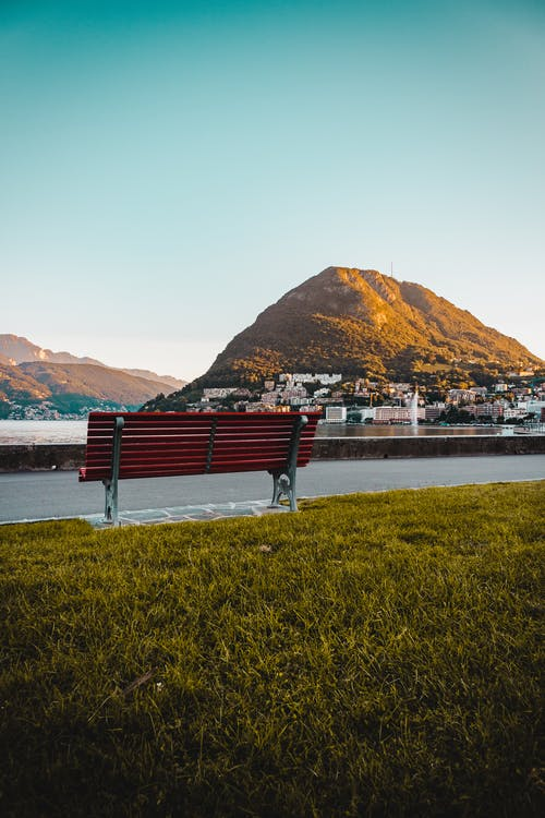 Red Wooden Outdoor Bench Near Mountain