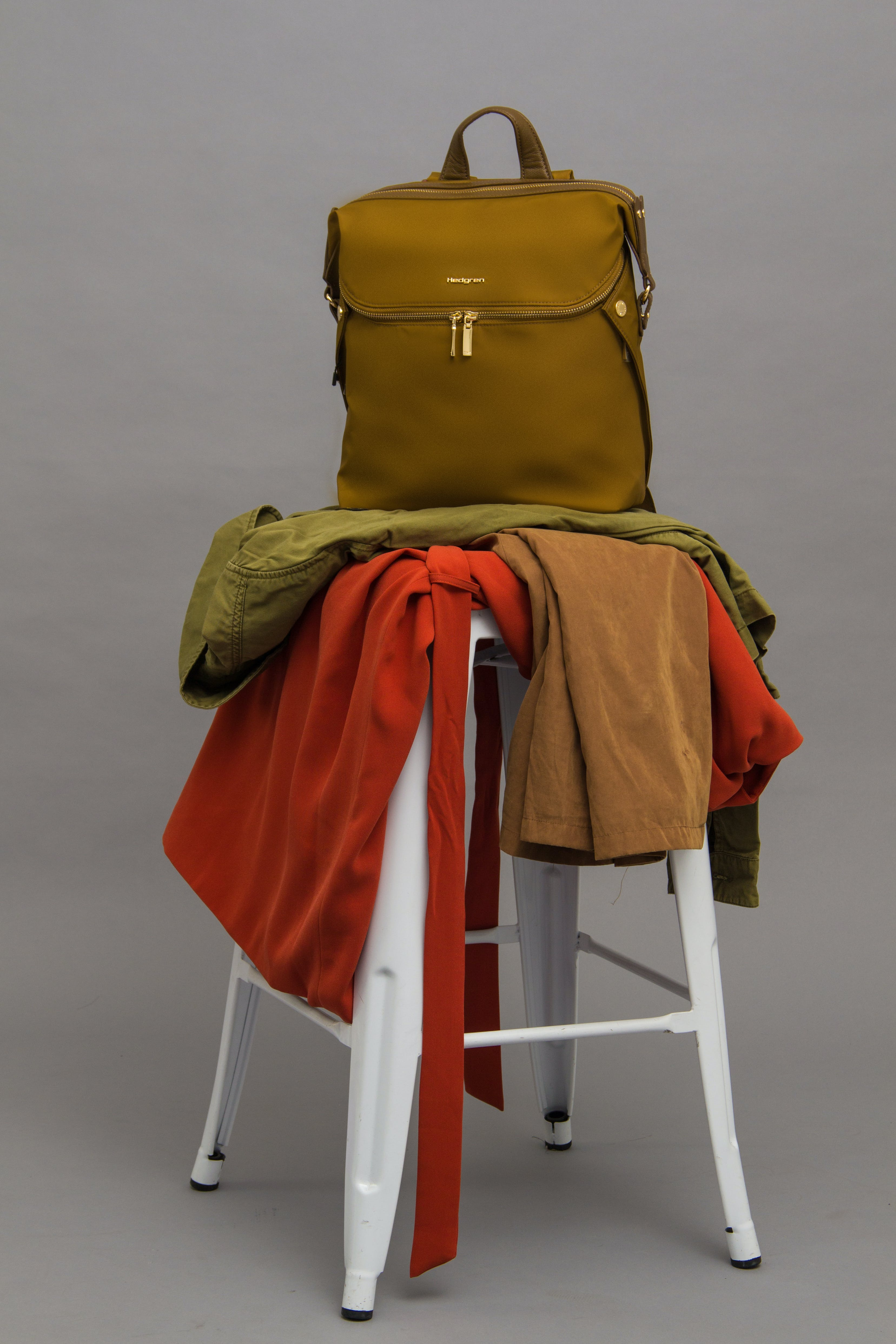 Brown Bag On Top Of Stool With Textiles