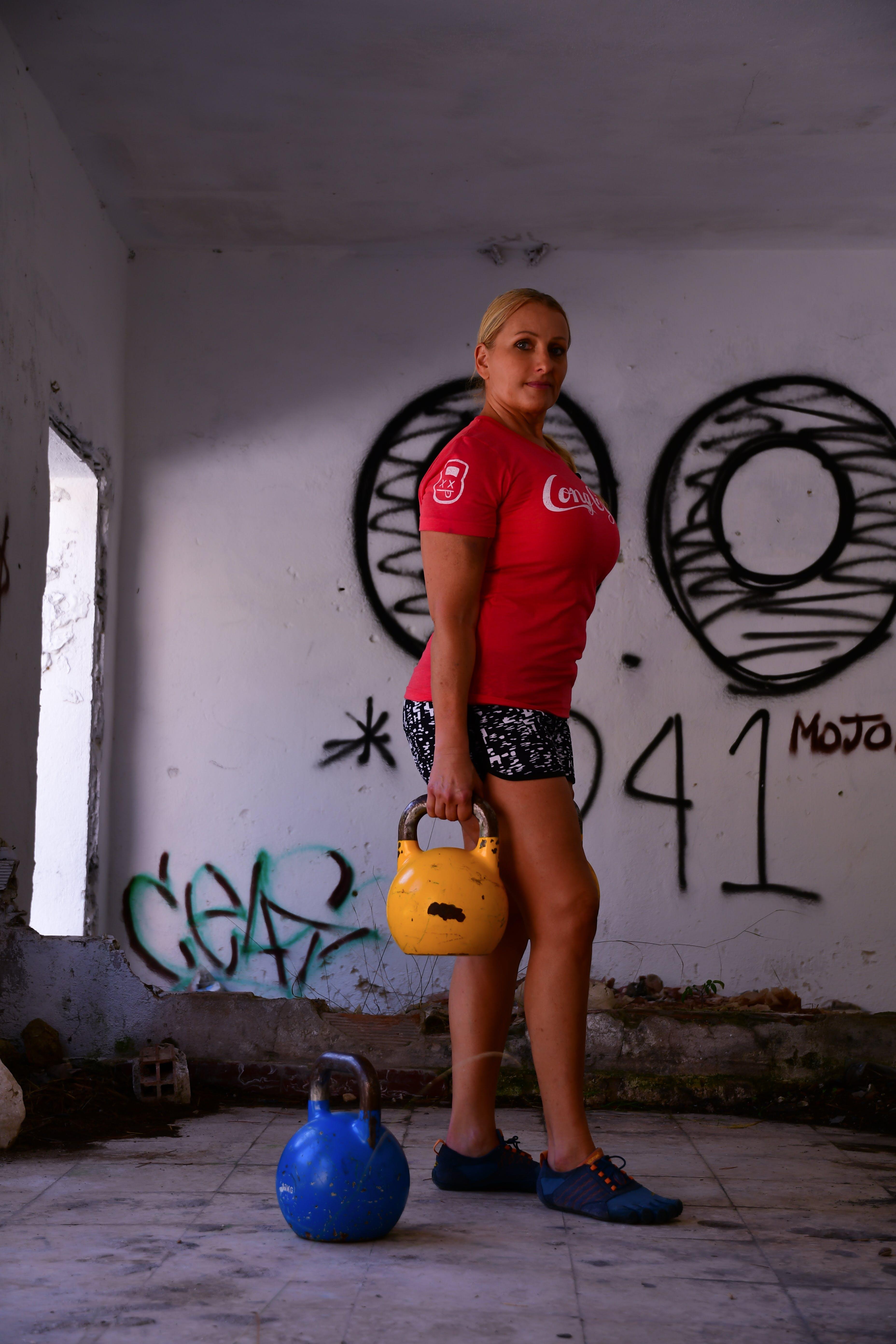 Free stock photo of strength, female, crossfit, kettlebell
