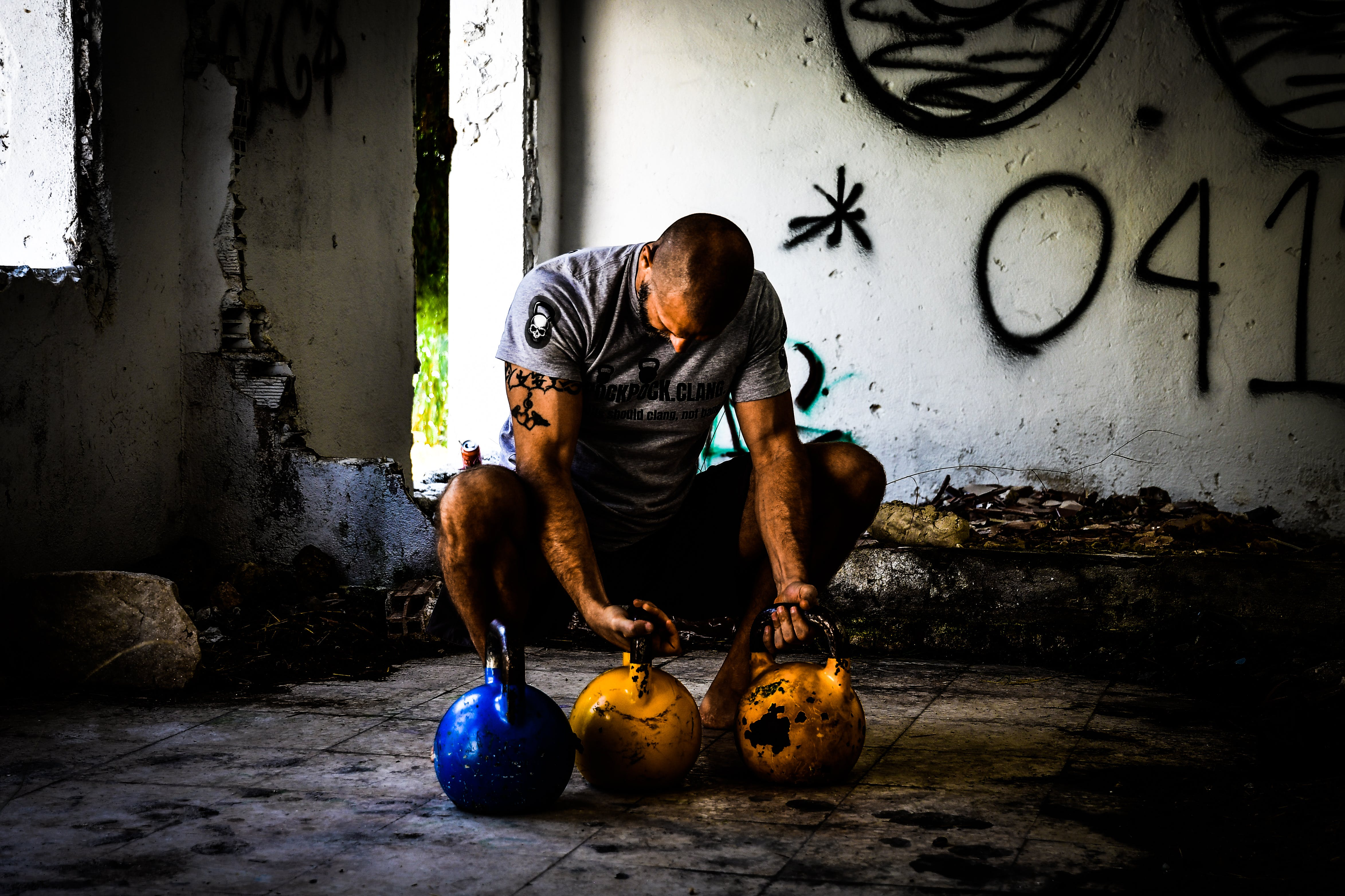 Free stock photo of exercise, crossfit, kettlebell, crouching