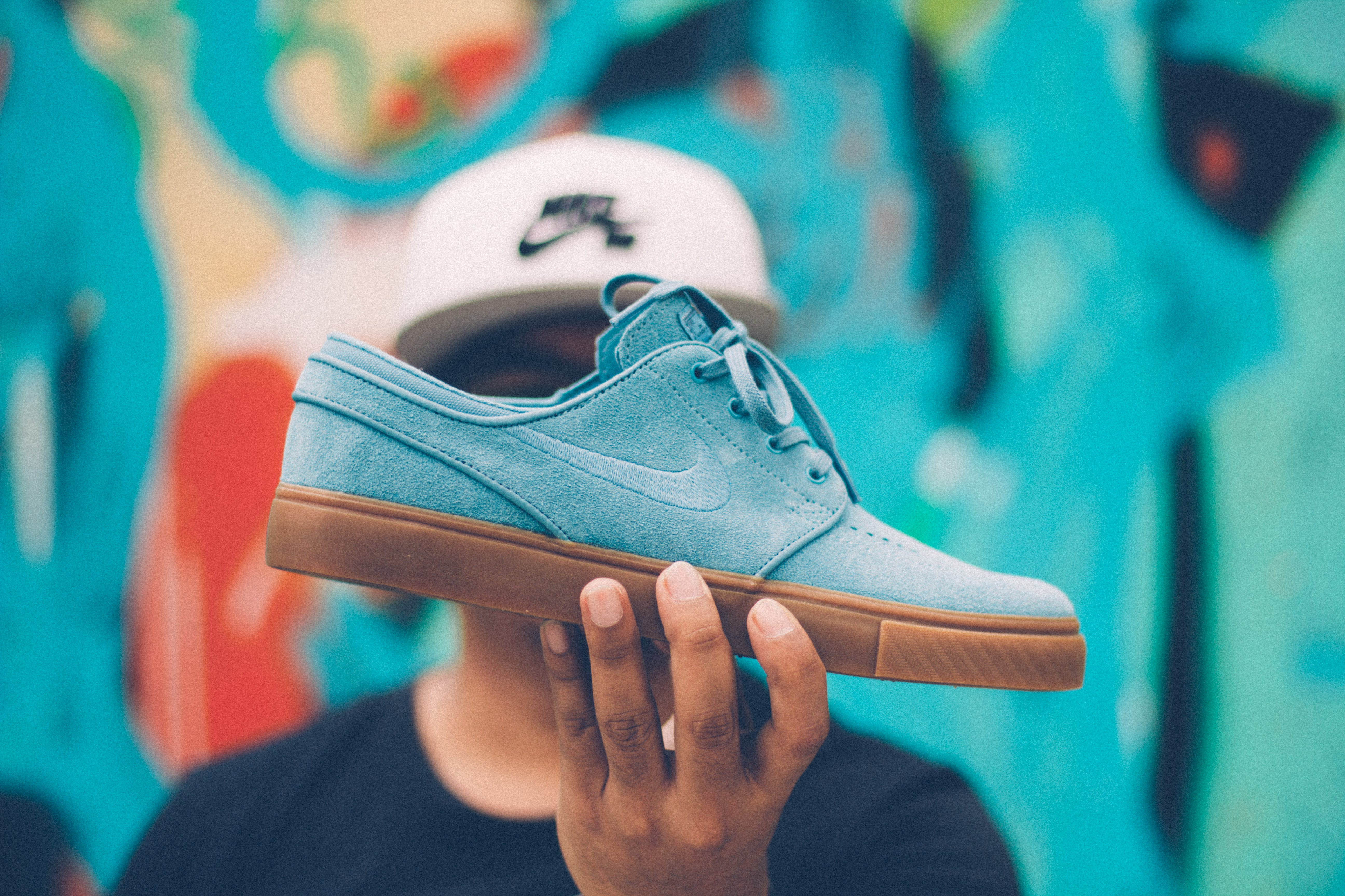 Person Holding Nike Sb Suede Low-top Sneaker