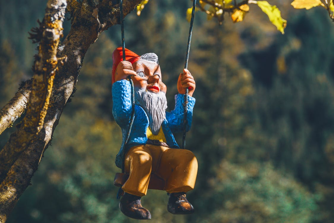 Gnome On Swing Chair