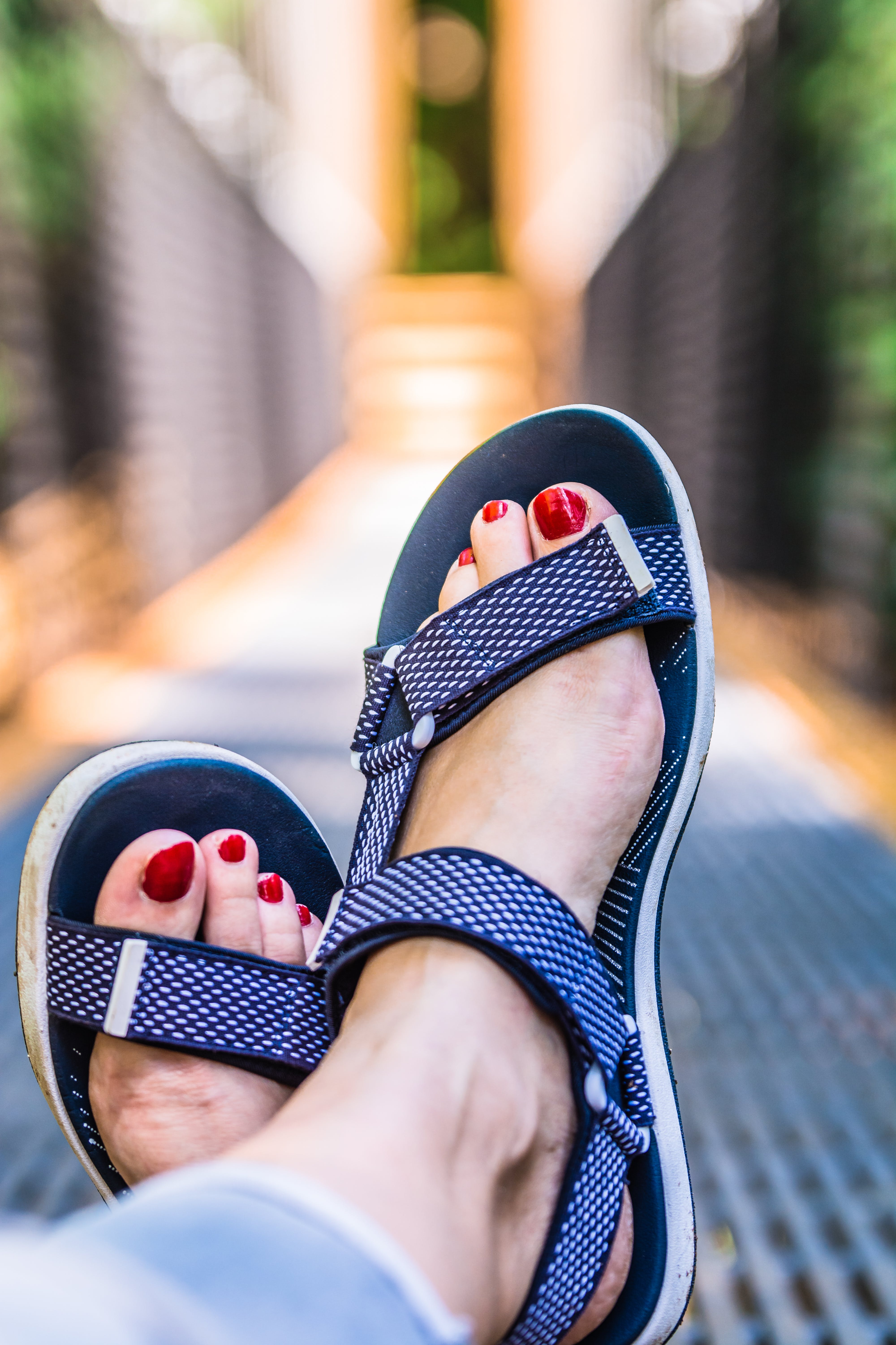 Person Wearing White And Blue Hiking Sandals