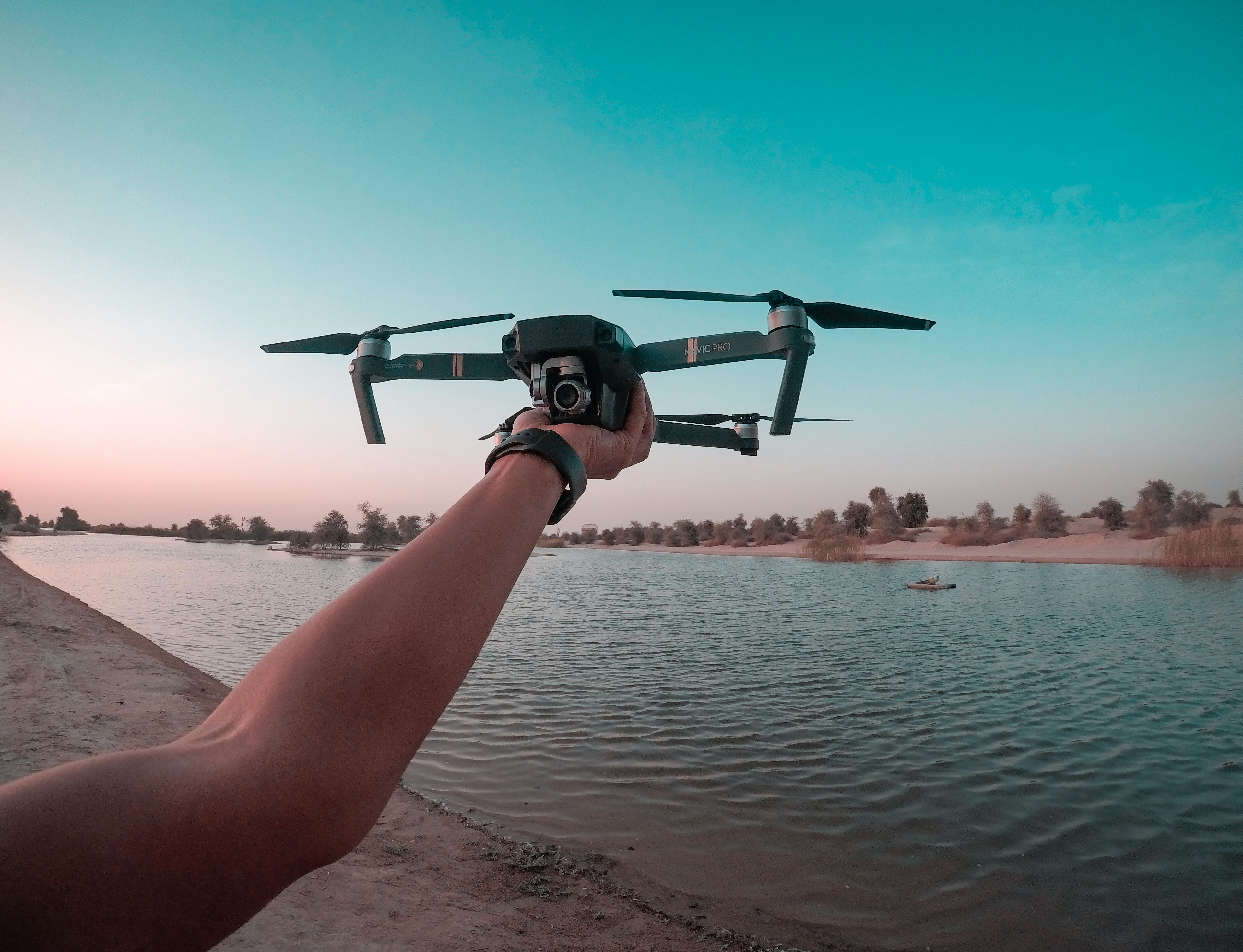 Photo of a Person Holding a Drone
