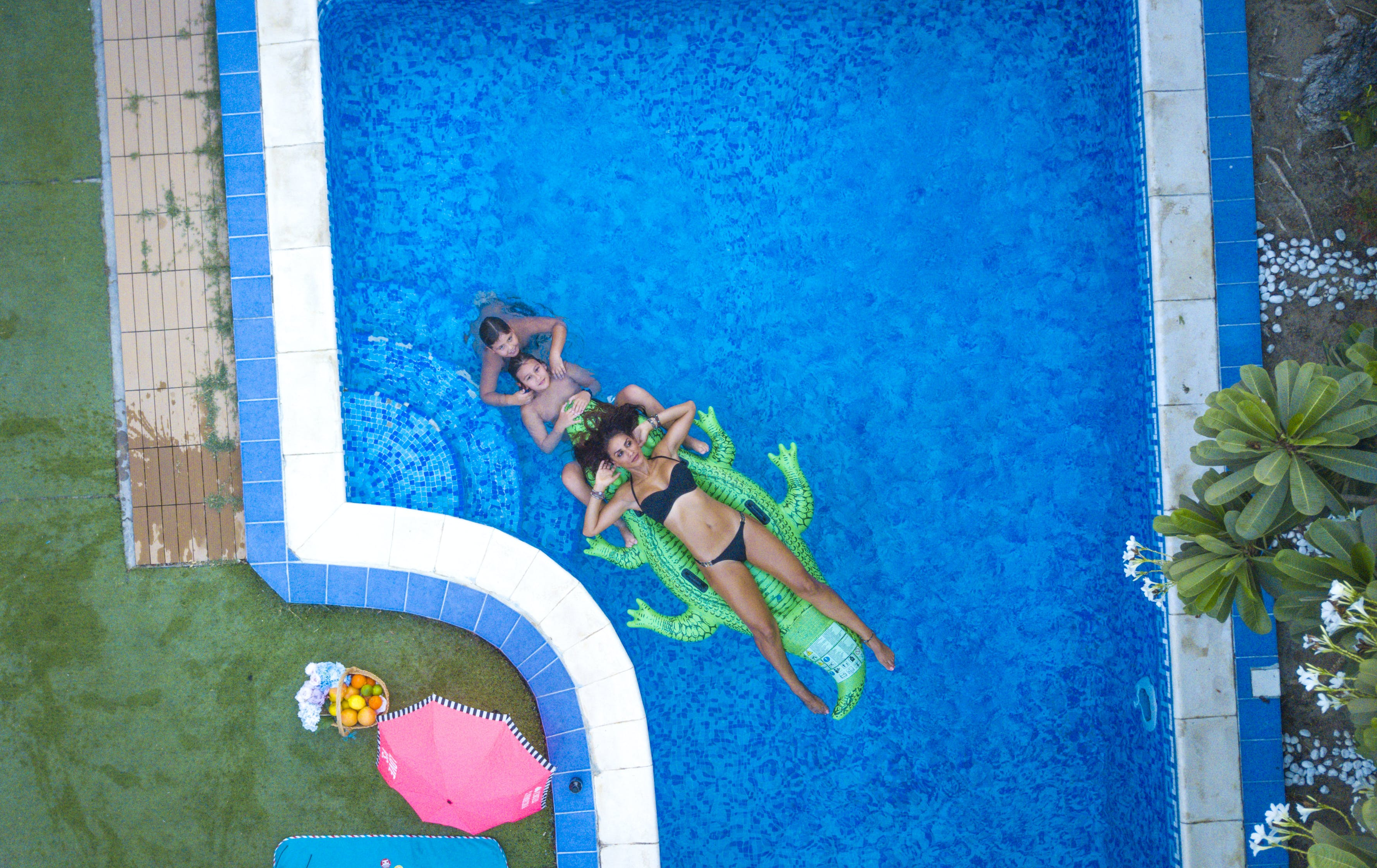 Aerial Photography Of Three People Swimming