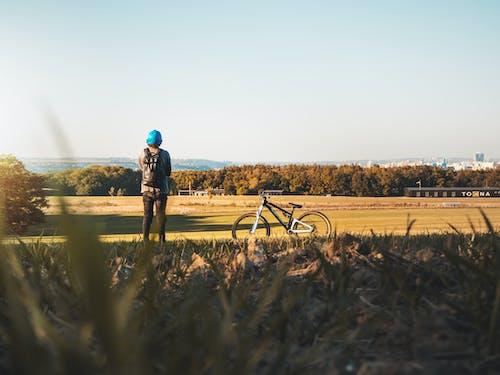 Person Standing Near Bike