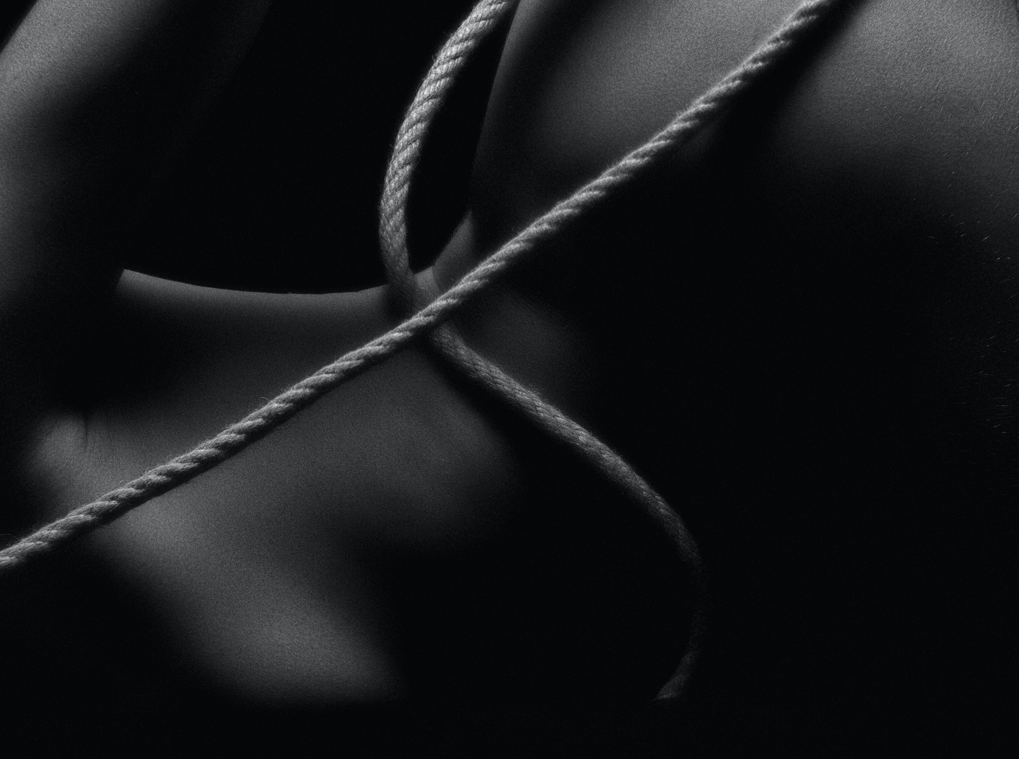 Monochrome Photo of Rope On Body