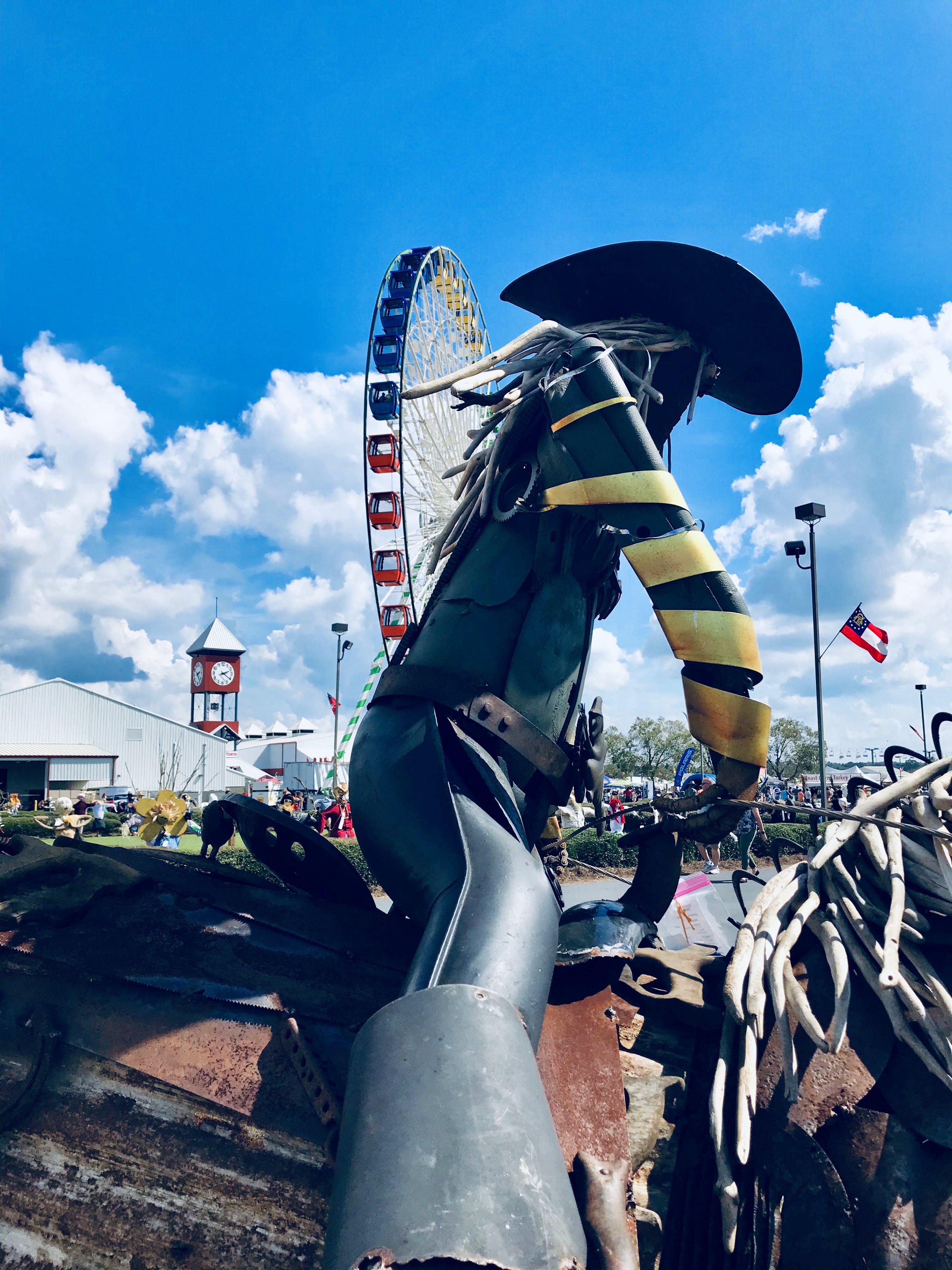 Free stock photo of art, clock tower, cowboy, fair