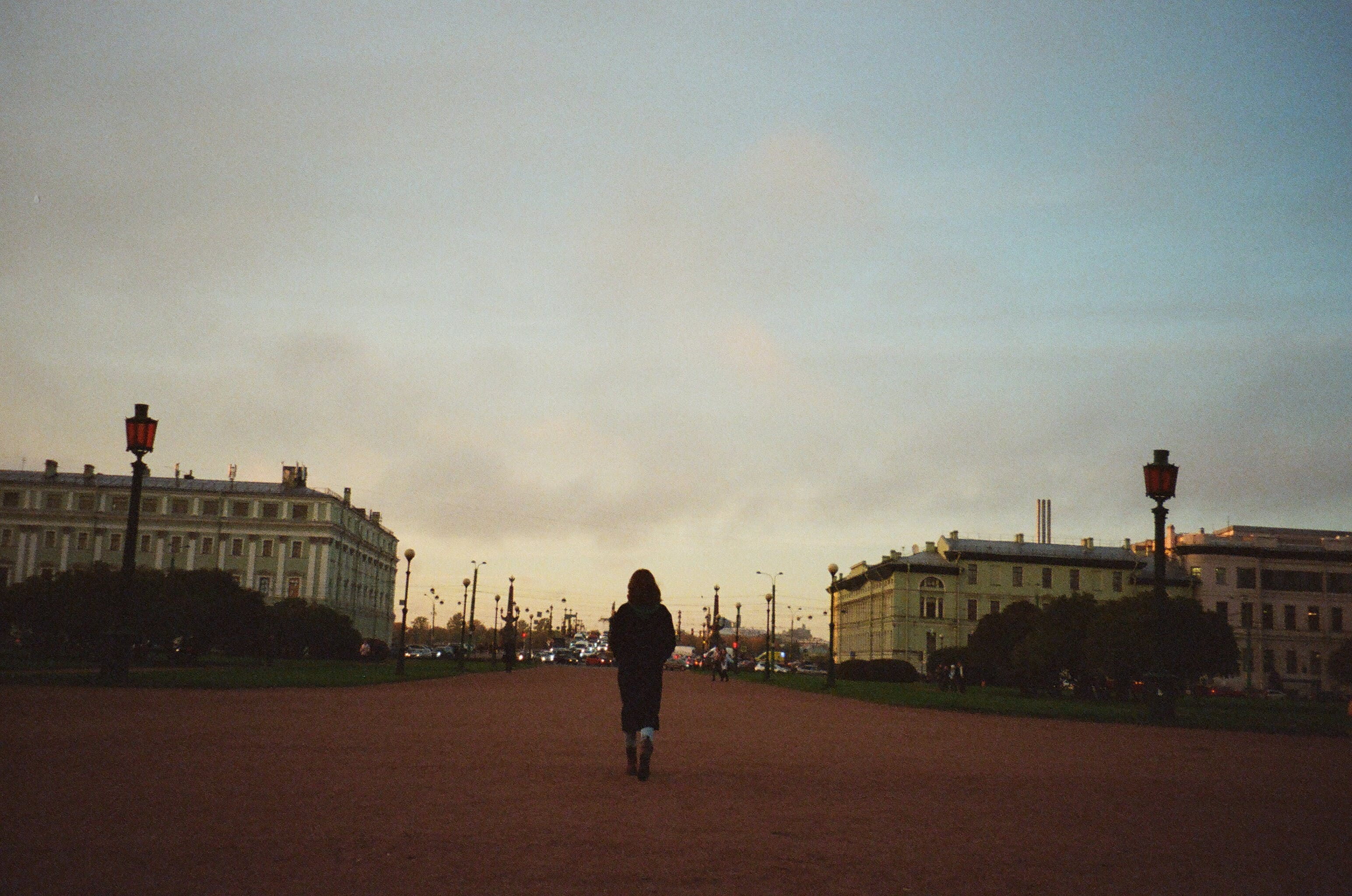 Woman Walking Towards City