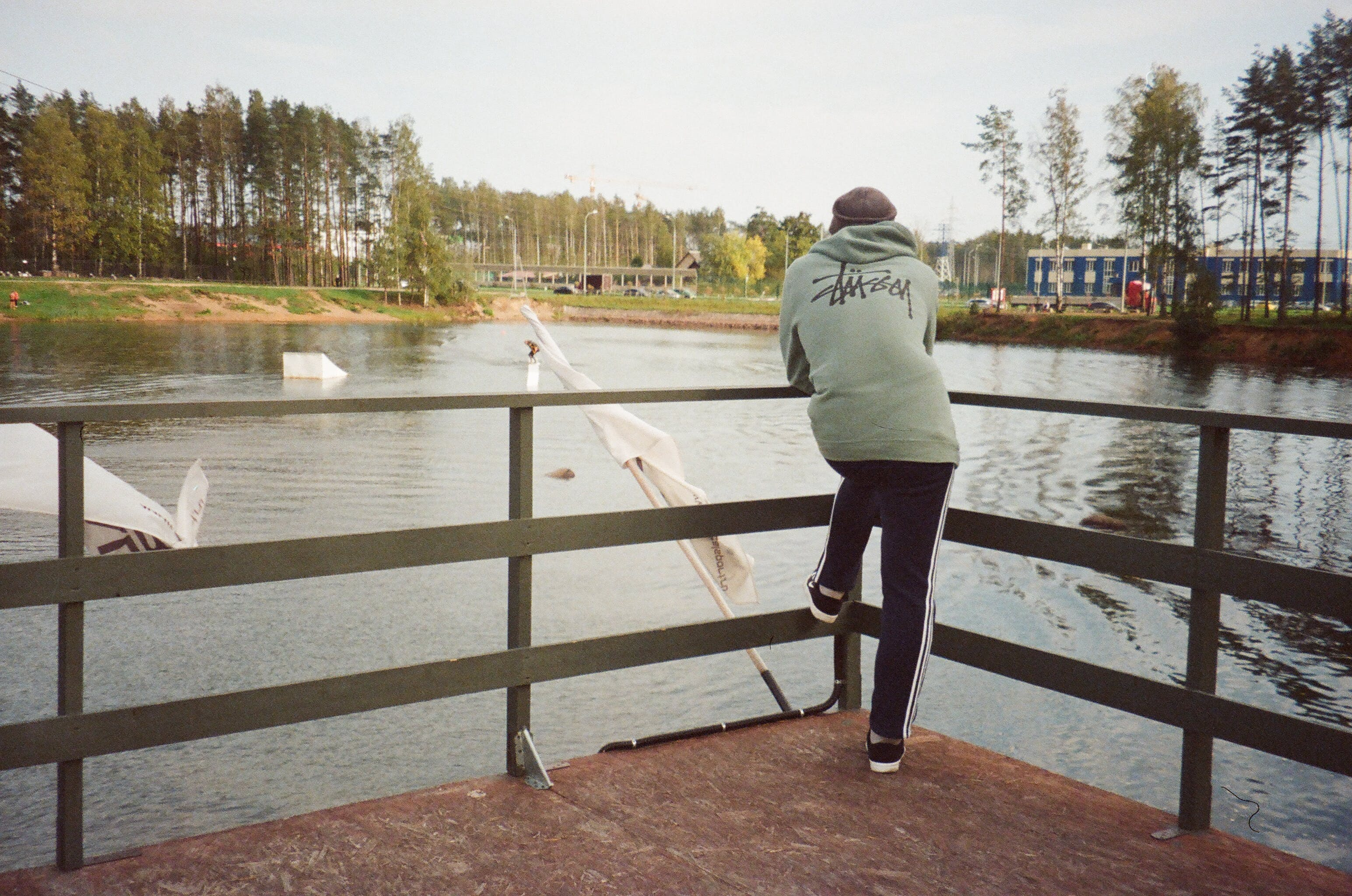 Photo of a Person Standing in Front of a Lake